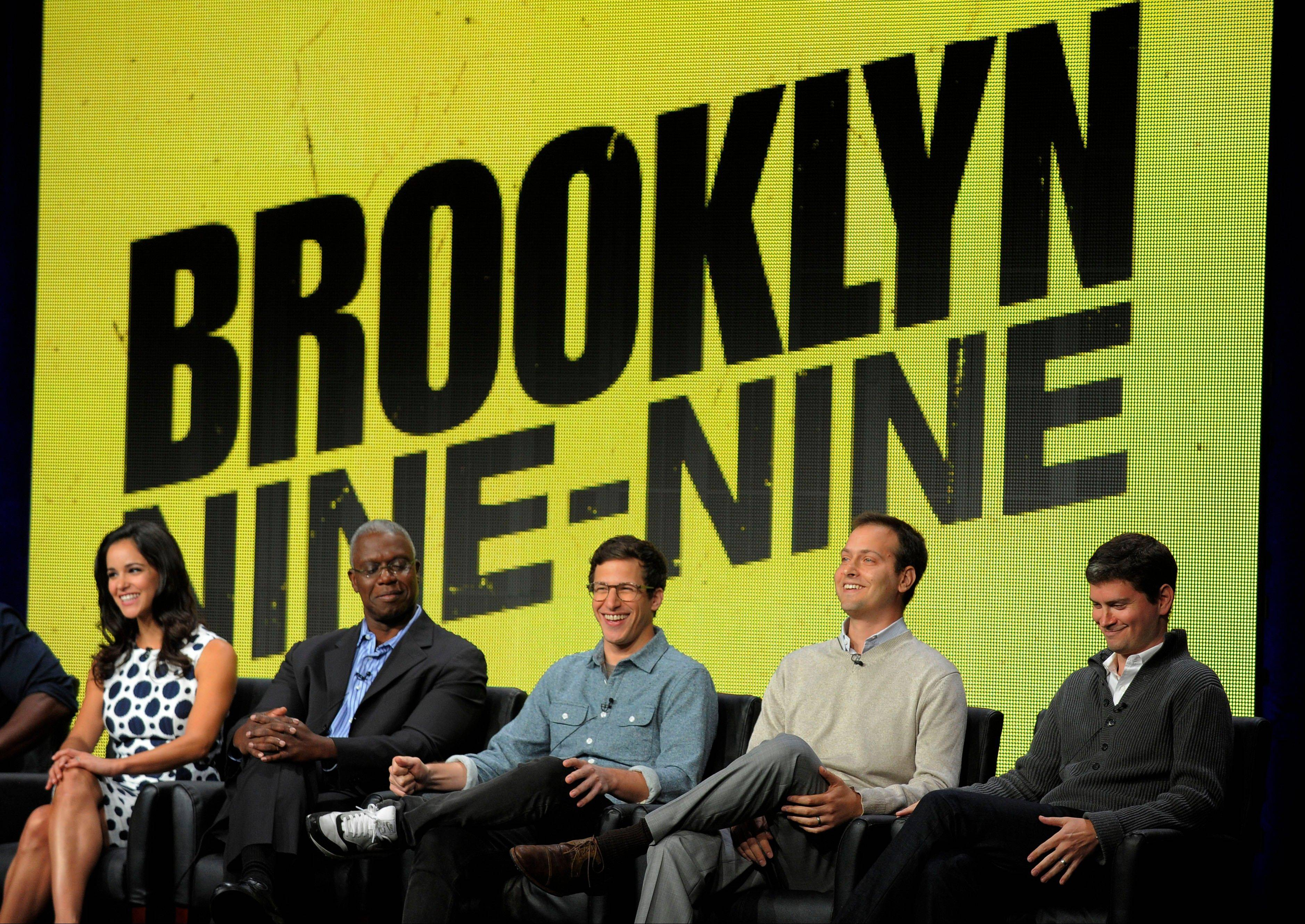 "From left, ""Brooklyn Nine-Nine"" cast members Melissa Fumero, Andre Braugher and Andy Samberg, and co-creators/executive producers Dan Goor and Michael Schur take part in an Aug. 1 panel discussion on the series. Fox said Friday it's ordering nine more episodes for a full first season of 22 episodes."