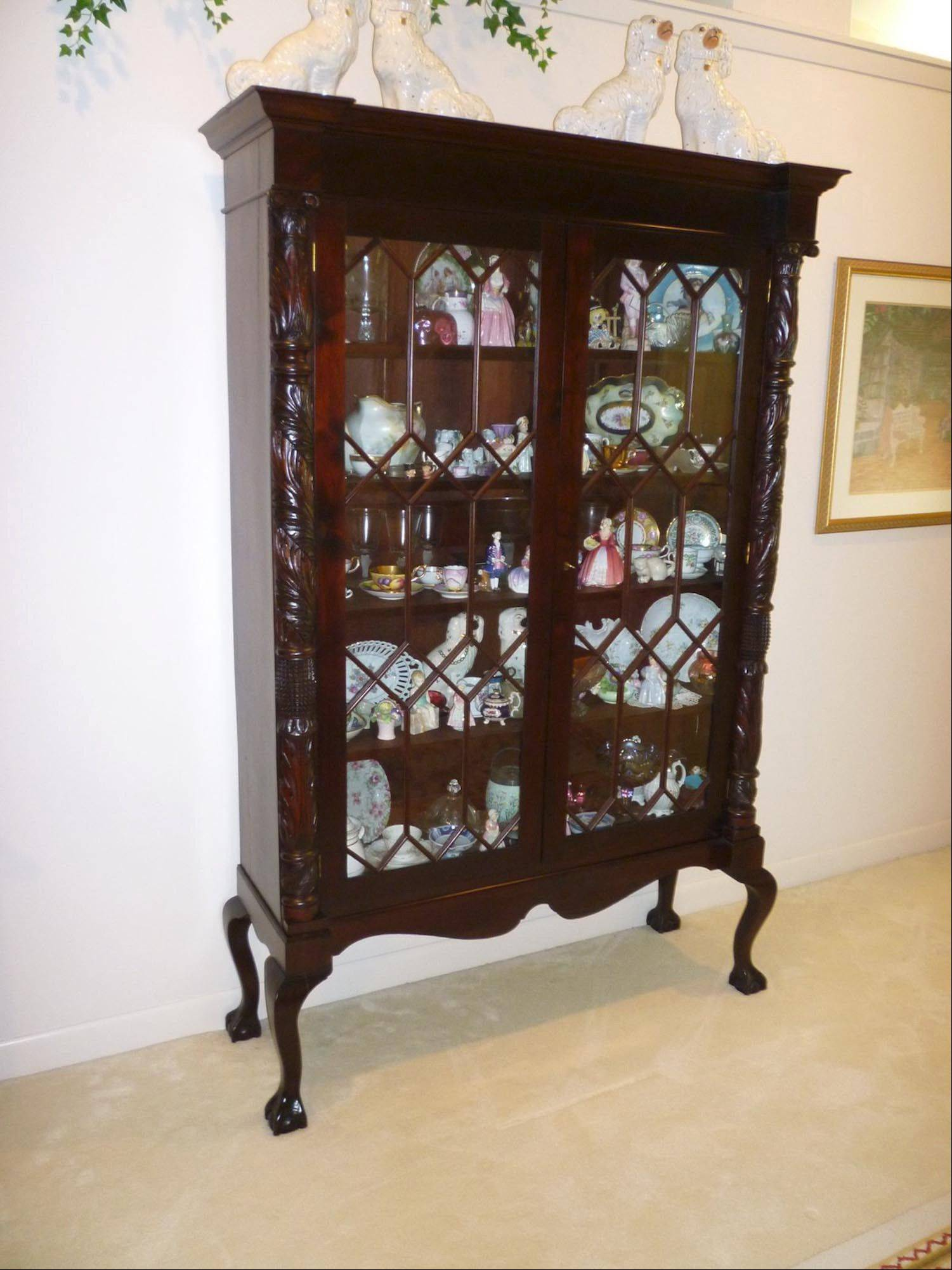 This china cabinet may seem to have the style of an antique to many, but what is its real age?
