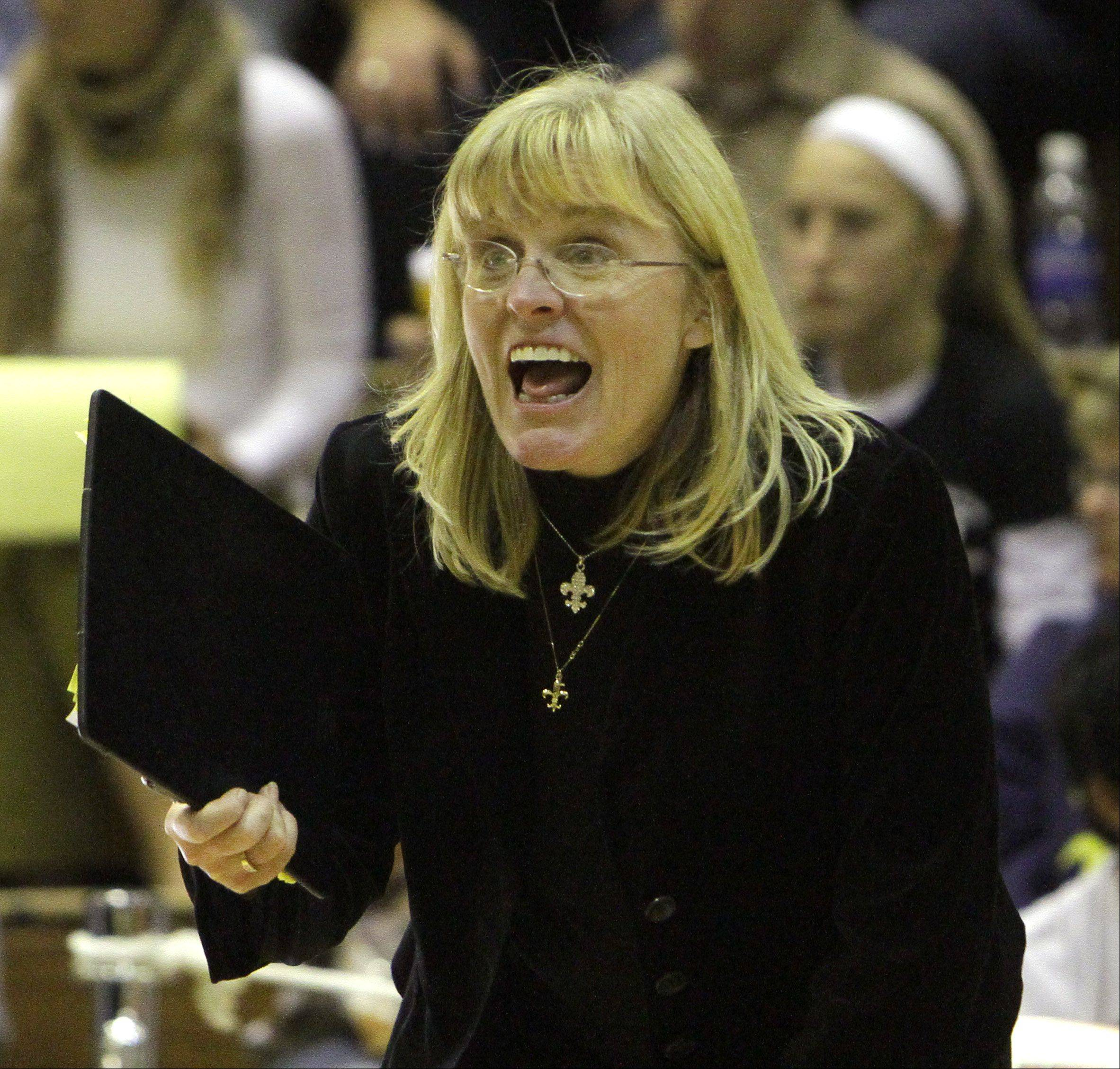 Kevin Sherman/ksherman@dailyherald.com ¬ St. Charles East girls volleyball head coach Jennie Kull shouts to her team during the final moments of their loss to Cary-Grove during their girls volleyball supersectional game in St. Charles on Saturday night.