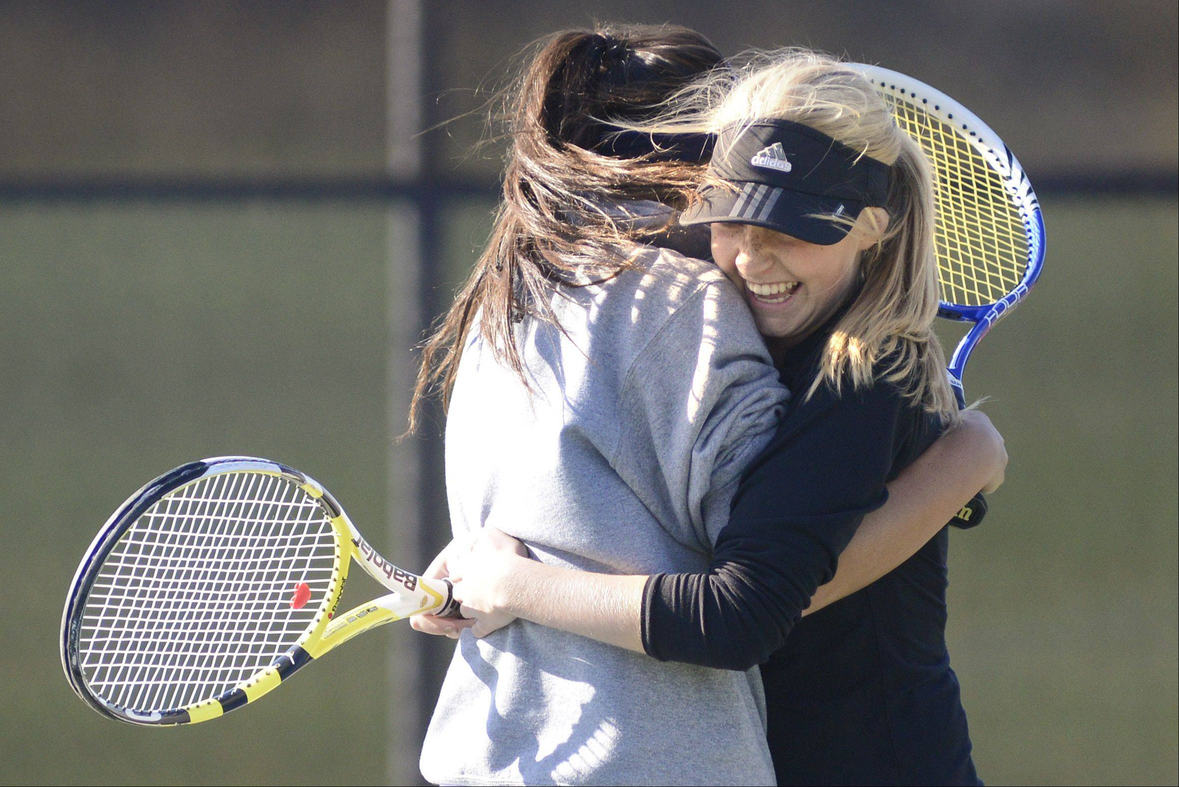 Geneva's Emma Hazel and Margo Hess embrace after winning the match vs. St. Charles East and qualifying for state in the sectional on Saturday, October 19.