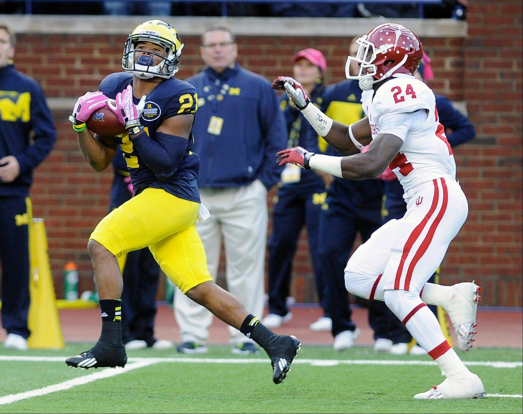 Michigan wide receiver Jeremy Gallon catches a third-quarter touchdown pass from quarterback Devin Gardner over Indiana defensive back Tim Bennett in Michigan�s 63-47 win at Michigan Stadium in Ann Arbor, Saturday.