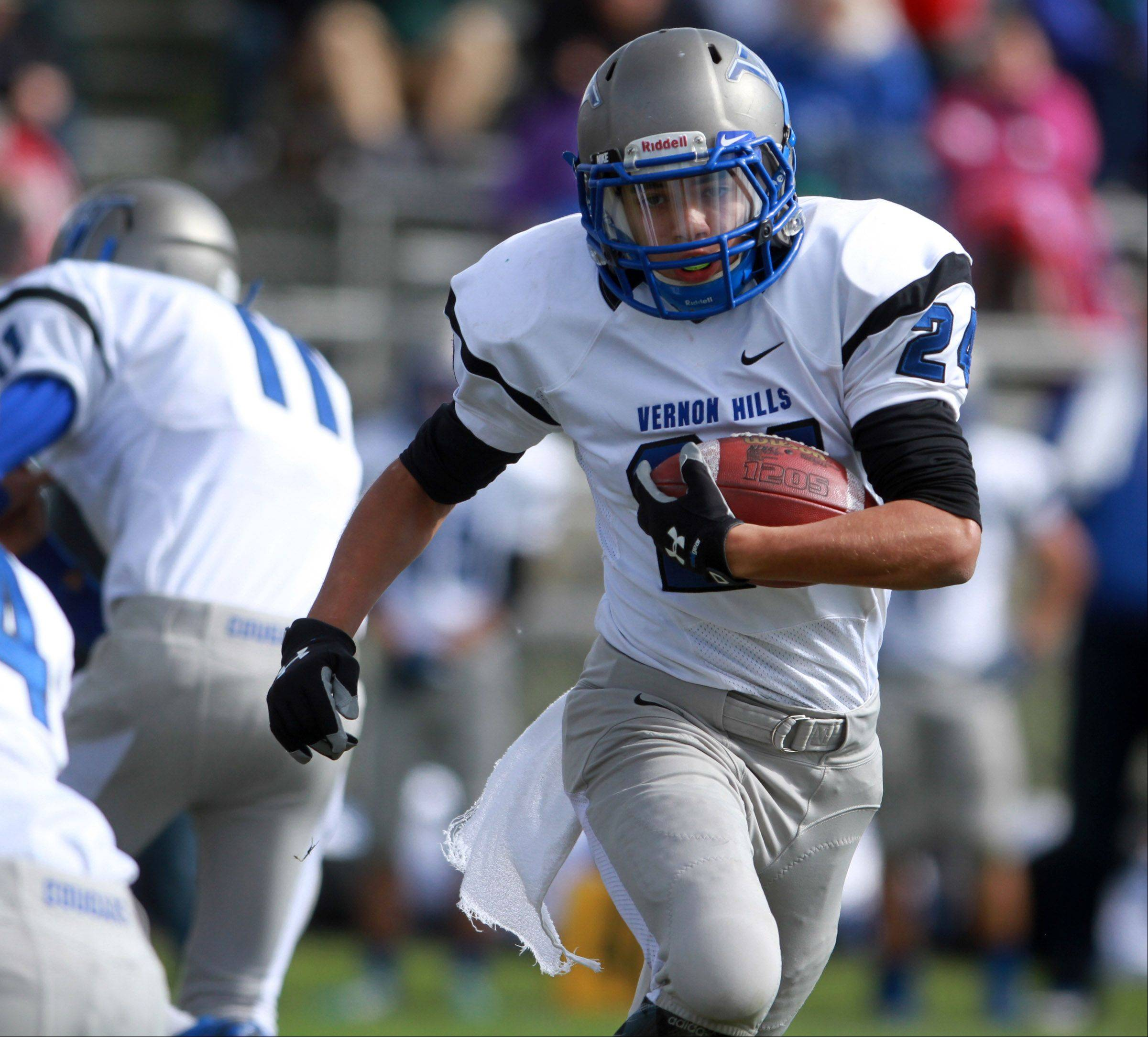 Vernon Hills running back Andres Salazar run up field against Round Lake at Round Lake on Saturday, October 19.