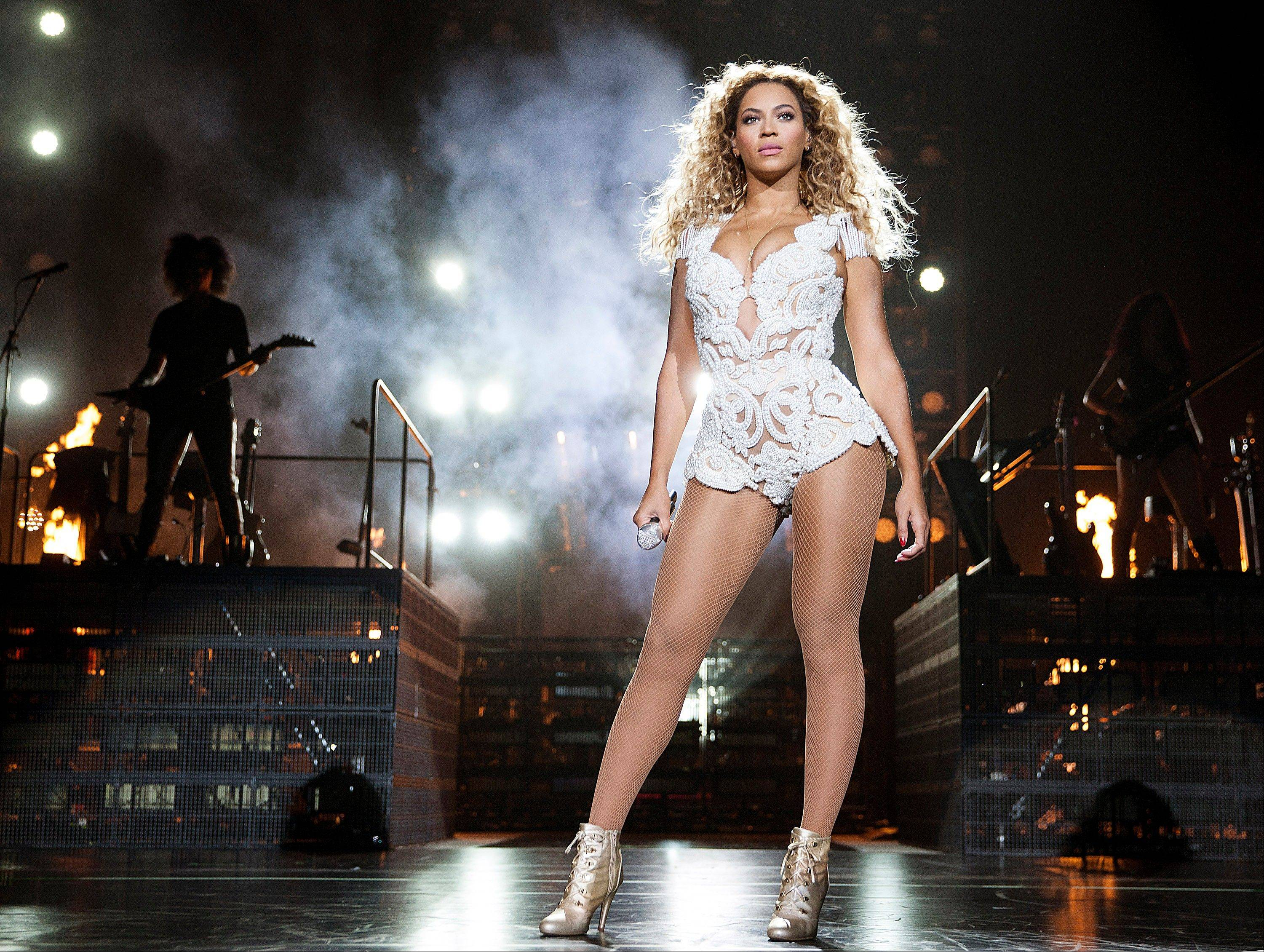 "Singer Beyonce performs on her ""Mrs. Carter Show World Tour 2013,"" on Wednesday at the Vector Arena in Auckland, New Zealand."