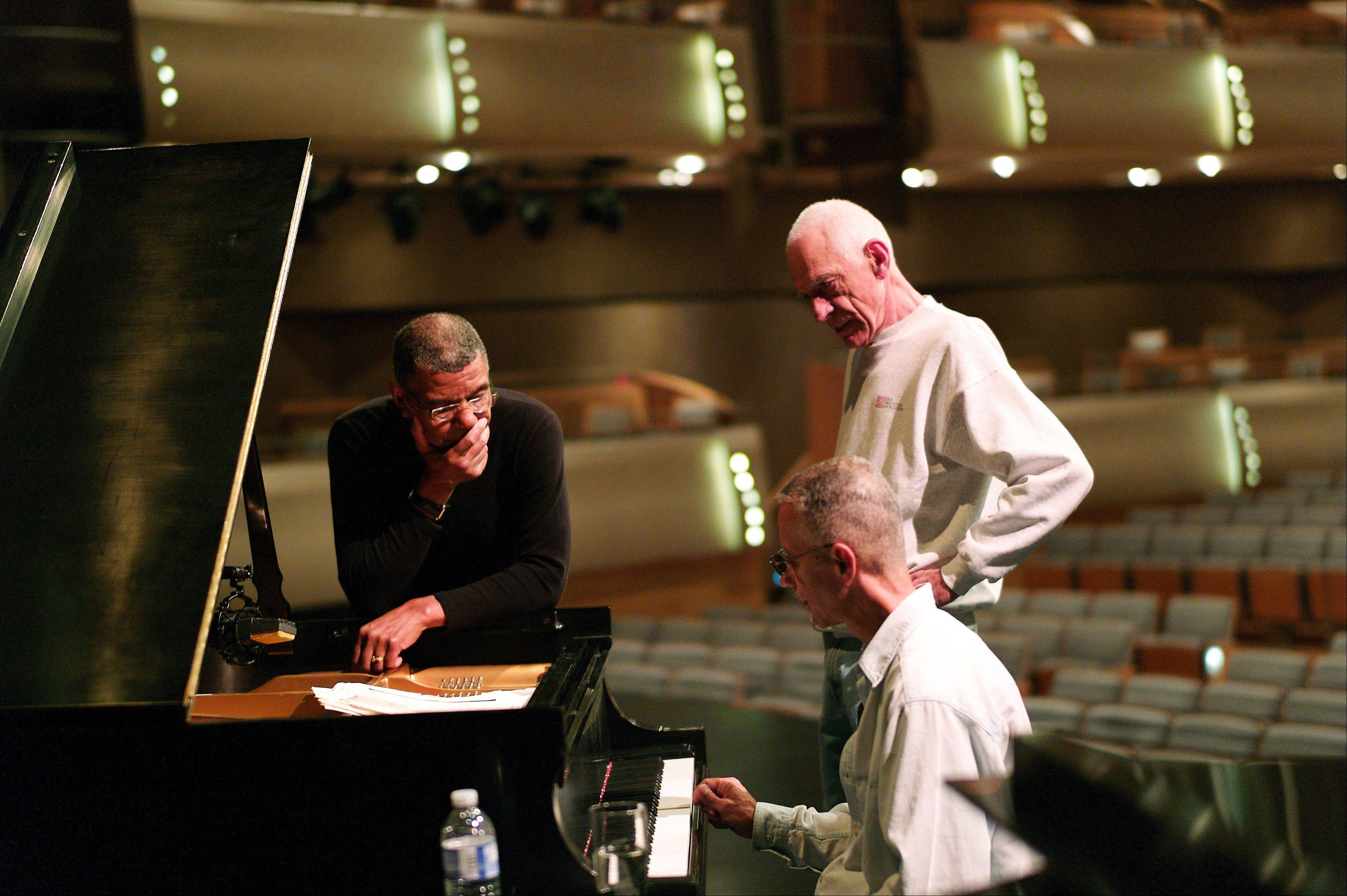 The Keith Jarrett Trio -- Keith Jarrett, seated, Jack DeJohnette, left, and Gary Peacock -- around the piano on a stage at the Four Seasons Center in Toronto. Jarrett's main focus this year has been his Standards trio with drummer DeJohnette and bassist Peacock, which is celebrating its 30th anniversary.