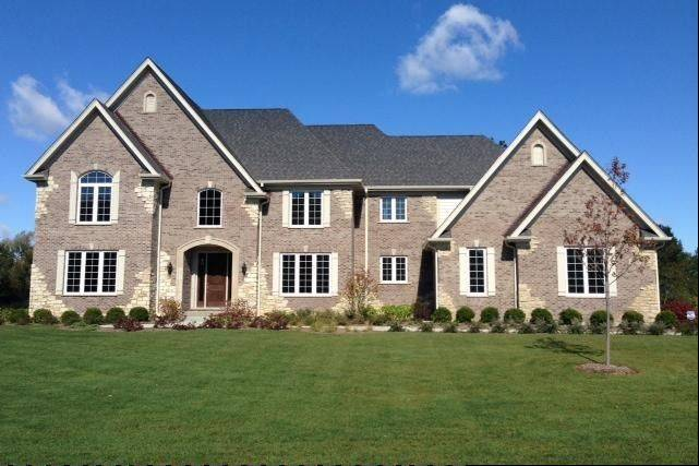 The brick and stone Woodleaf model is available for $899,000 at The Sanctuary Club in Kildeer.