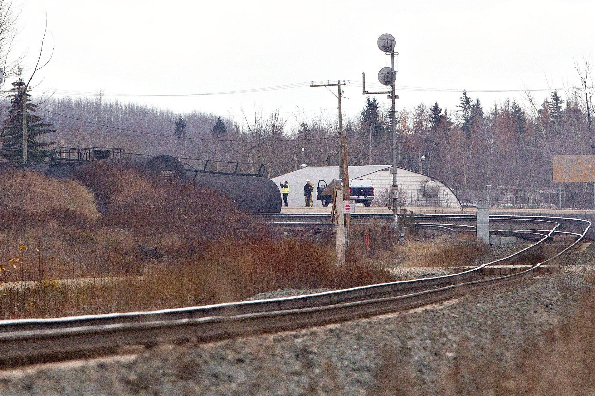 Emergency crews work at the scene of a train derailment near Gainford, Alberta, Canada, on Saturday. Canadian National spokesman Louis-Antoine Paquin said 13 cars -- four carrying petroleum crude oil and nine loaded with liquefied petroleum gas -- came off the tracks around 1 a.m. local time about 50 miles (80 kilometers) from Edmonton. The entire community of roughly 100 people was evacuated.