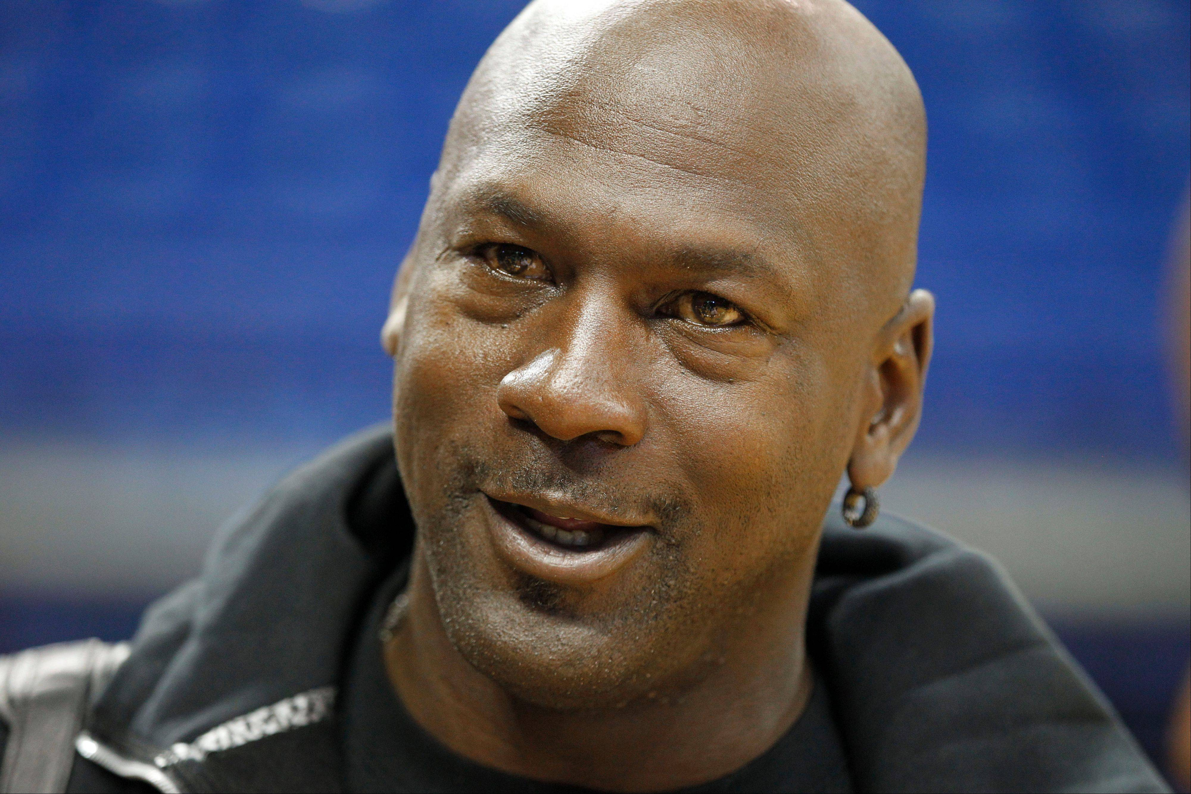 In this Oct. 2, 2012, file photo, Charlotte Bobcats owner Michael Jordan attends a practice at NBA basketball training camp in Asheville, N.C.