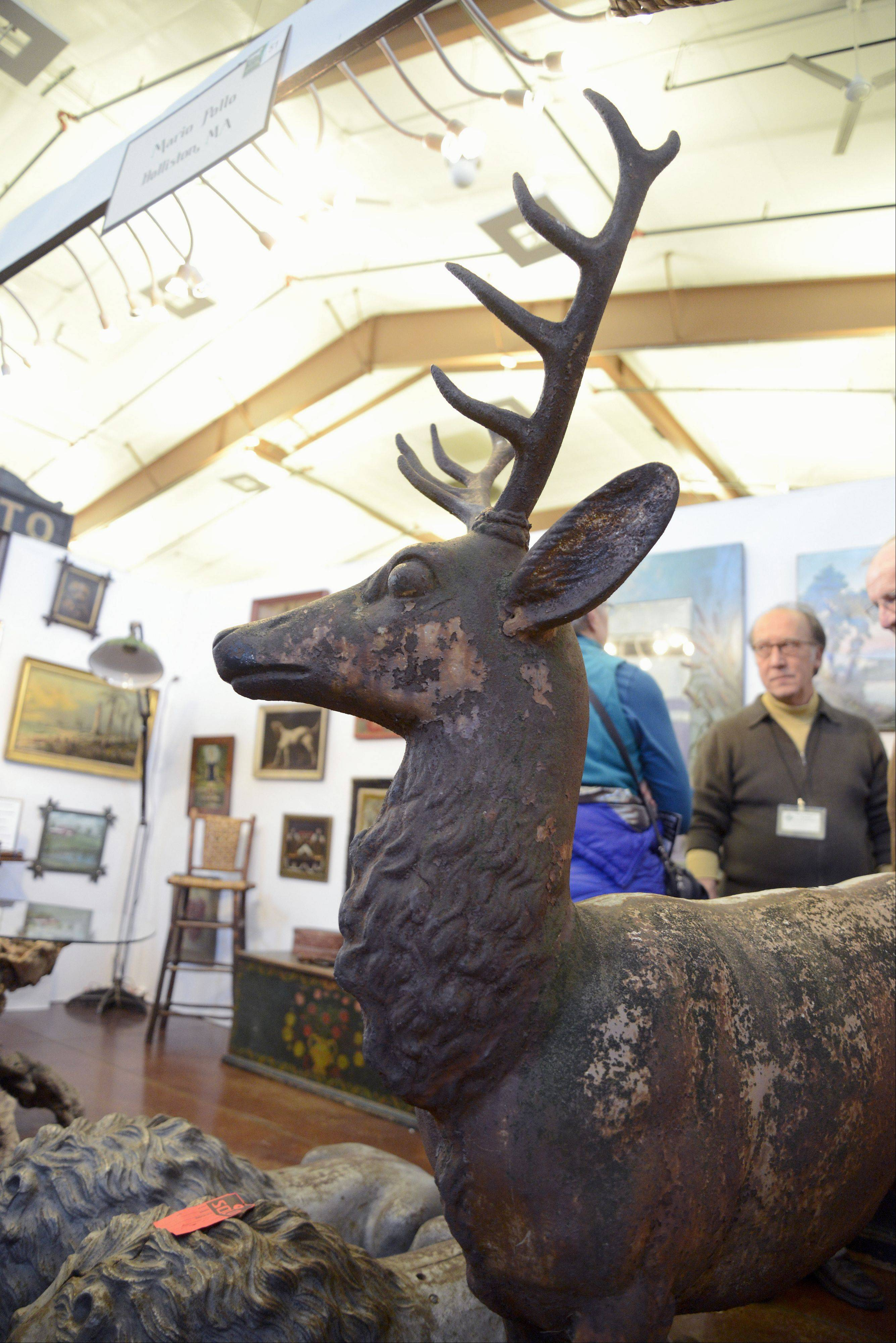 A cast-iron deer statue dating from 1880 by a New York City foundry stands on display in Mario Pollo's booth (from Holliston, Mass.) at the 39th annual Fox Valley Antiques Show at the Kane County Fairgrounds. Fifty-five dealers from 17 states participate in the show, which is by invitation only and continues Sunday.
