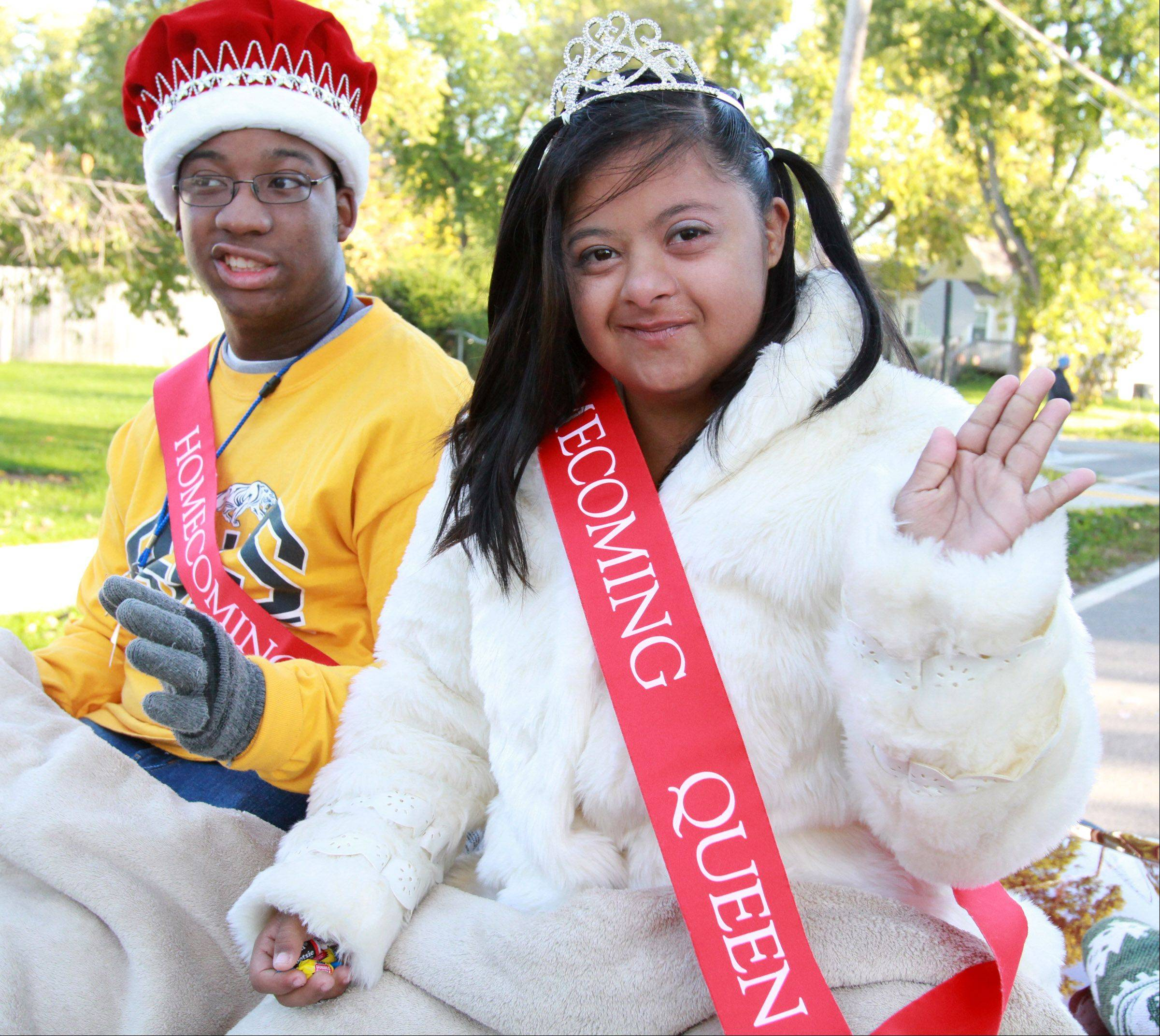 "Devonaire Daley, left, and Lourdes ""Lulu"" Reyes have won the hearts of their Round Lake High School classmates, who voted them homecoming king and queen."