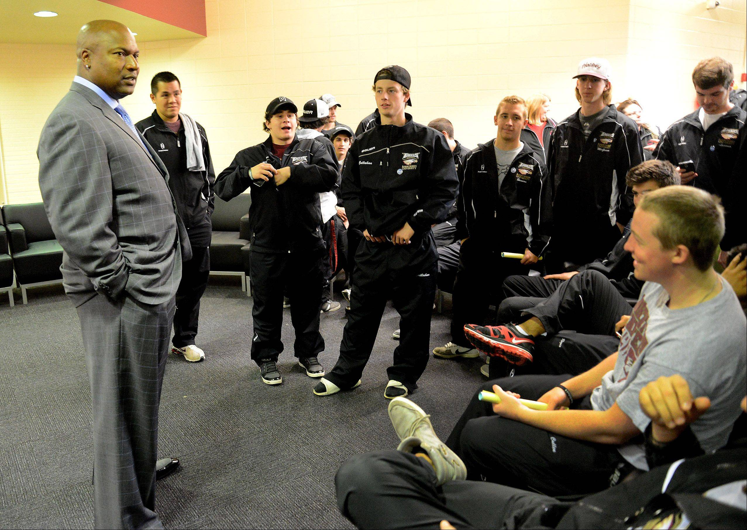 Football and baseball legend Bo Jackson talks to members of the Robert Morris University football team on Friday in Arlington Heights.