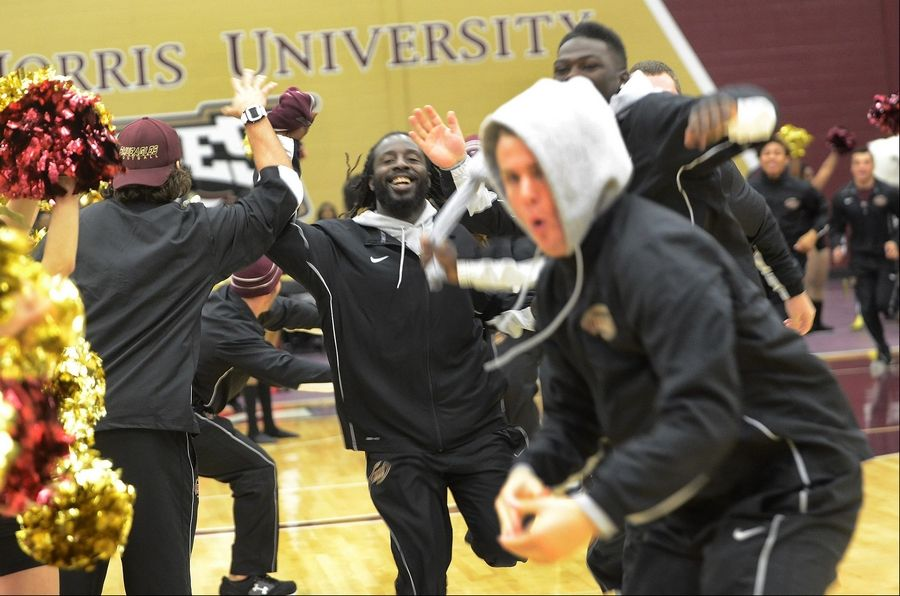 The Robert Morris University football team is introduced Friday during a Homecoming pep rally at the school's new athletic convocation center in Arlington Heights.