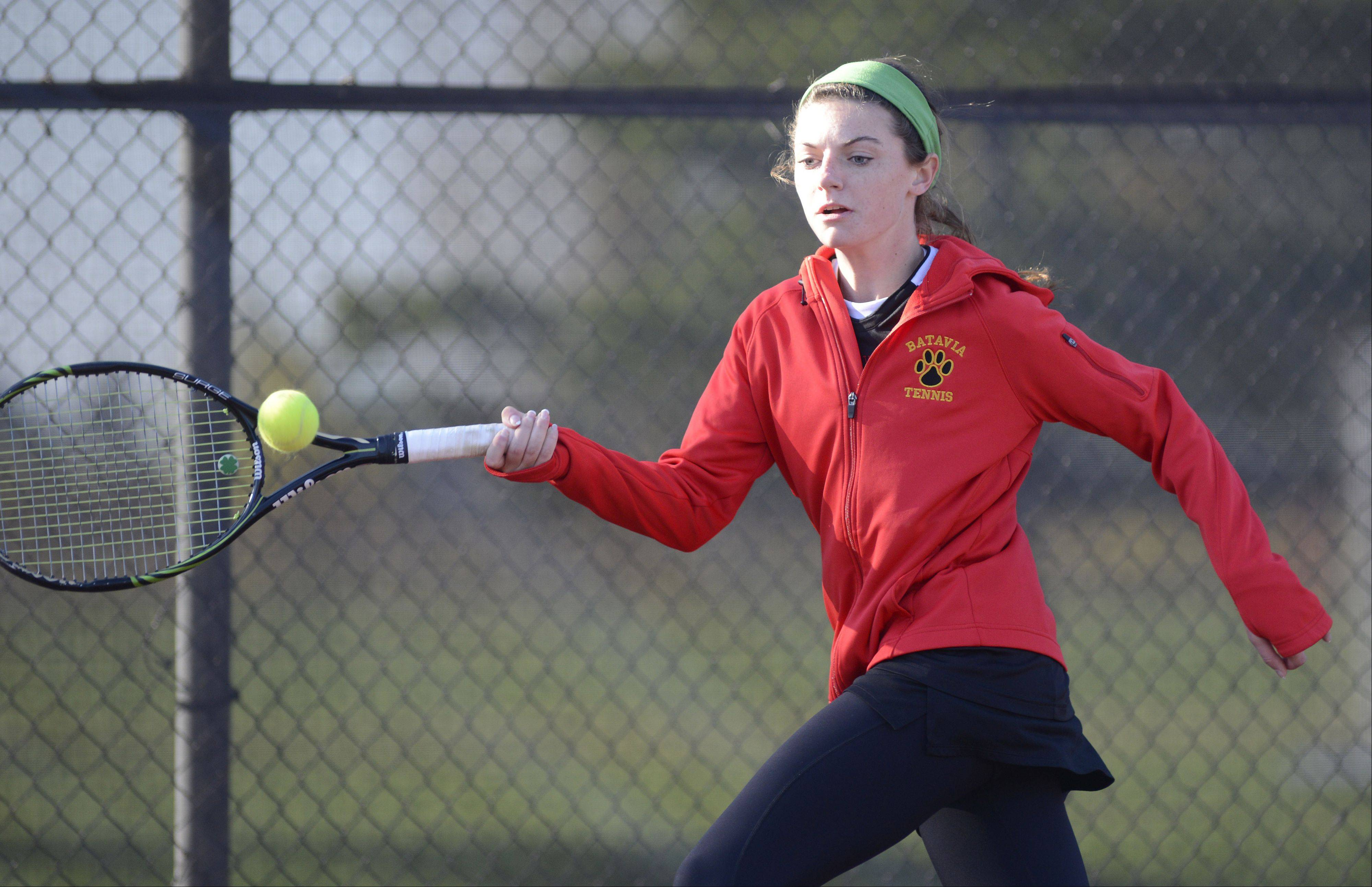 Batavia's Nora McClure returns a hit from St. Charles East's Jaci Spoerl in the singles match at the sectional on Saturday, October 19.