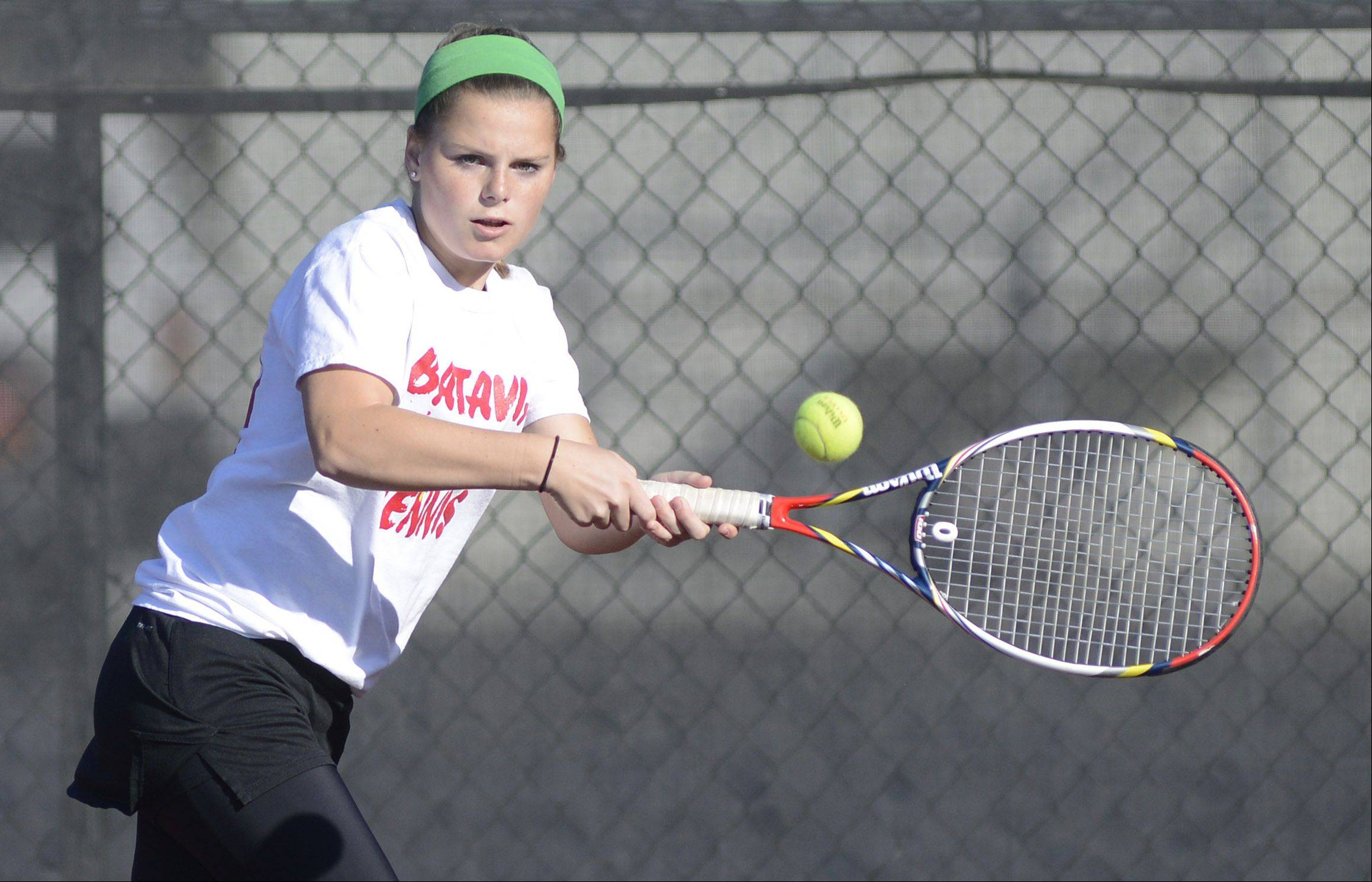 Batavia doubles player Sydney Unterberg returns a hit from Bartlett at the sectional meet on Saturday, October 19.
