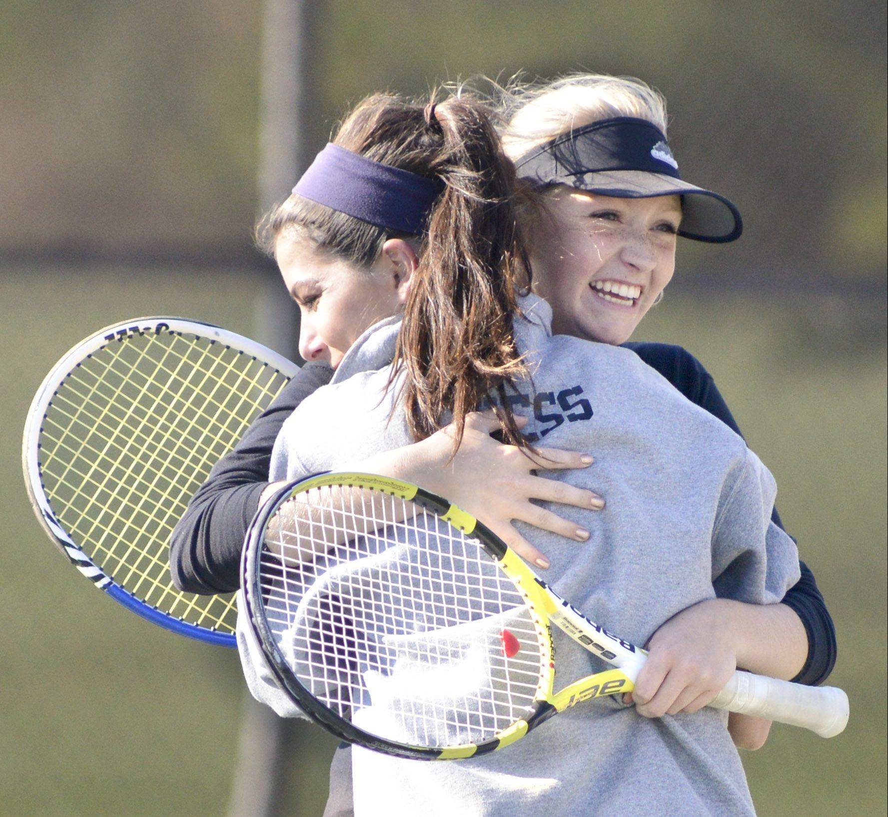 Geneva's Emma Hazel (facing) and Margo Hess embrace after winning the match vs. St. Charles East and qualifying for state in the sectional on Saturday, October 19.