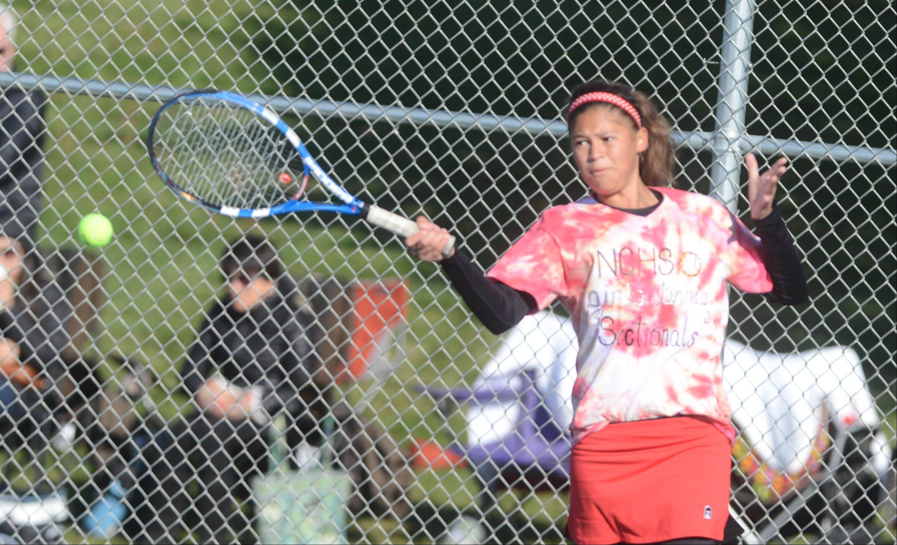 Cass Goldner of Naperville Central takes a swing during the Naperville North girls tennis sectional Saturday. She was playing with teammate Cindy Liu.