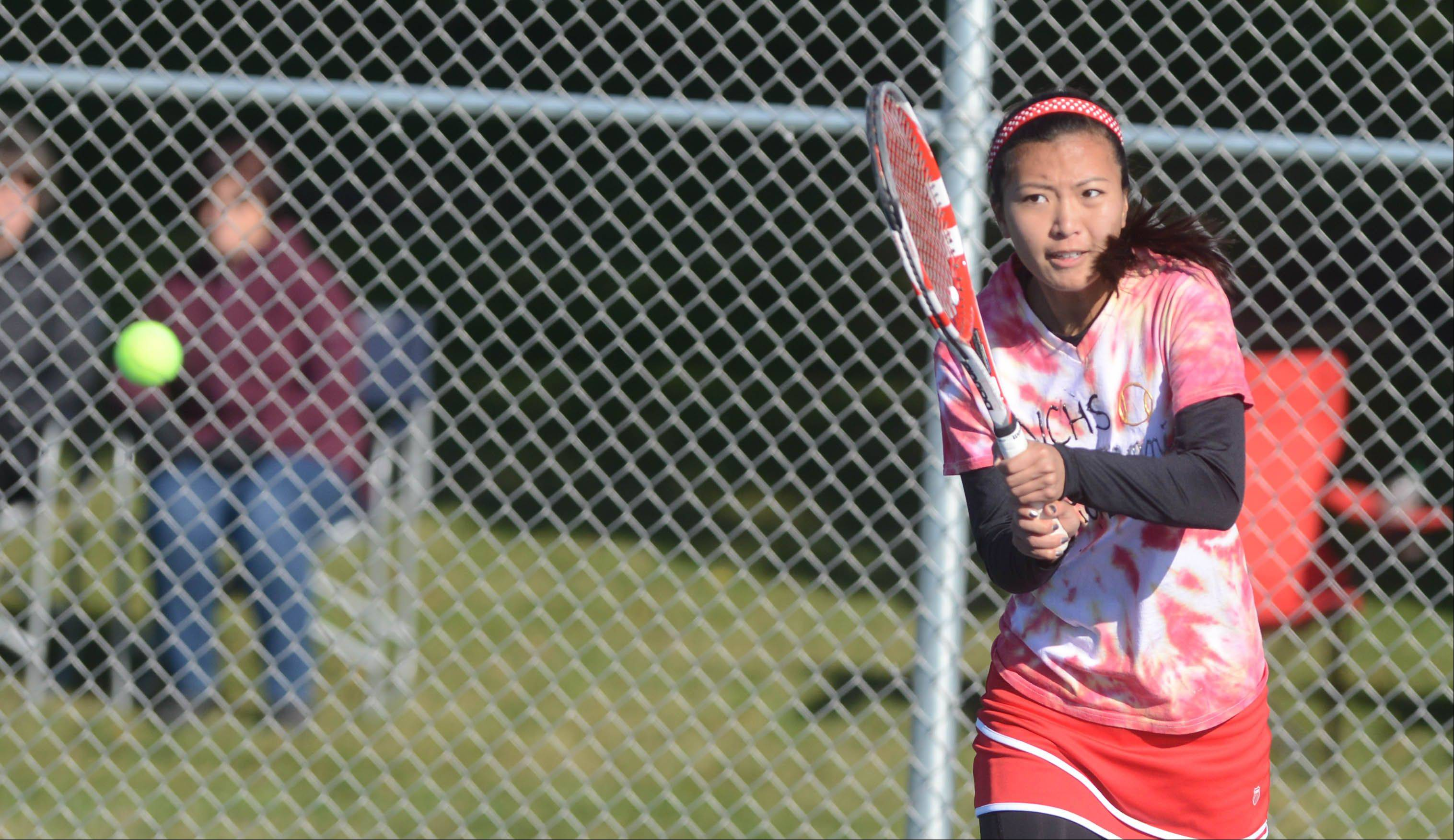 Cindy Liu of Naperville Central takes a swing during the Naperville North girls tennis sectional Saturday. She was playing with teammate Cass Goldner.