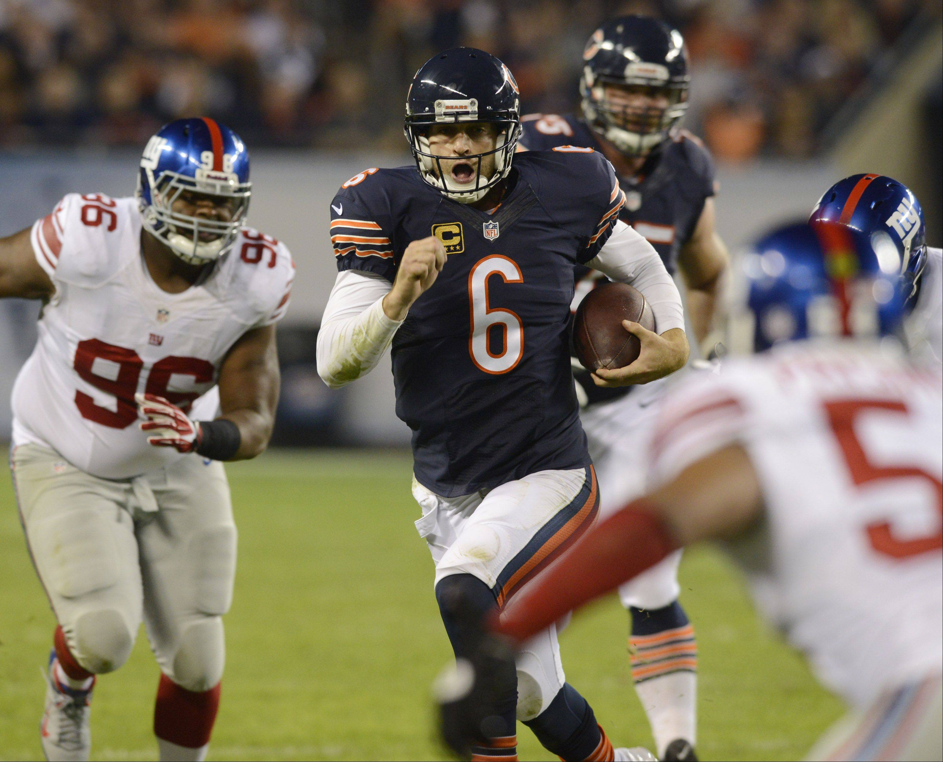 Bears quarterback Jay Cutler runs for yardage during his team's victory over the New York Giants in Week 6 at Soldier Field.