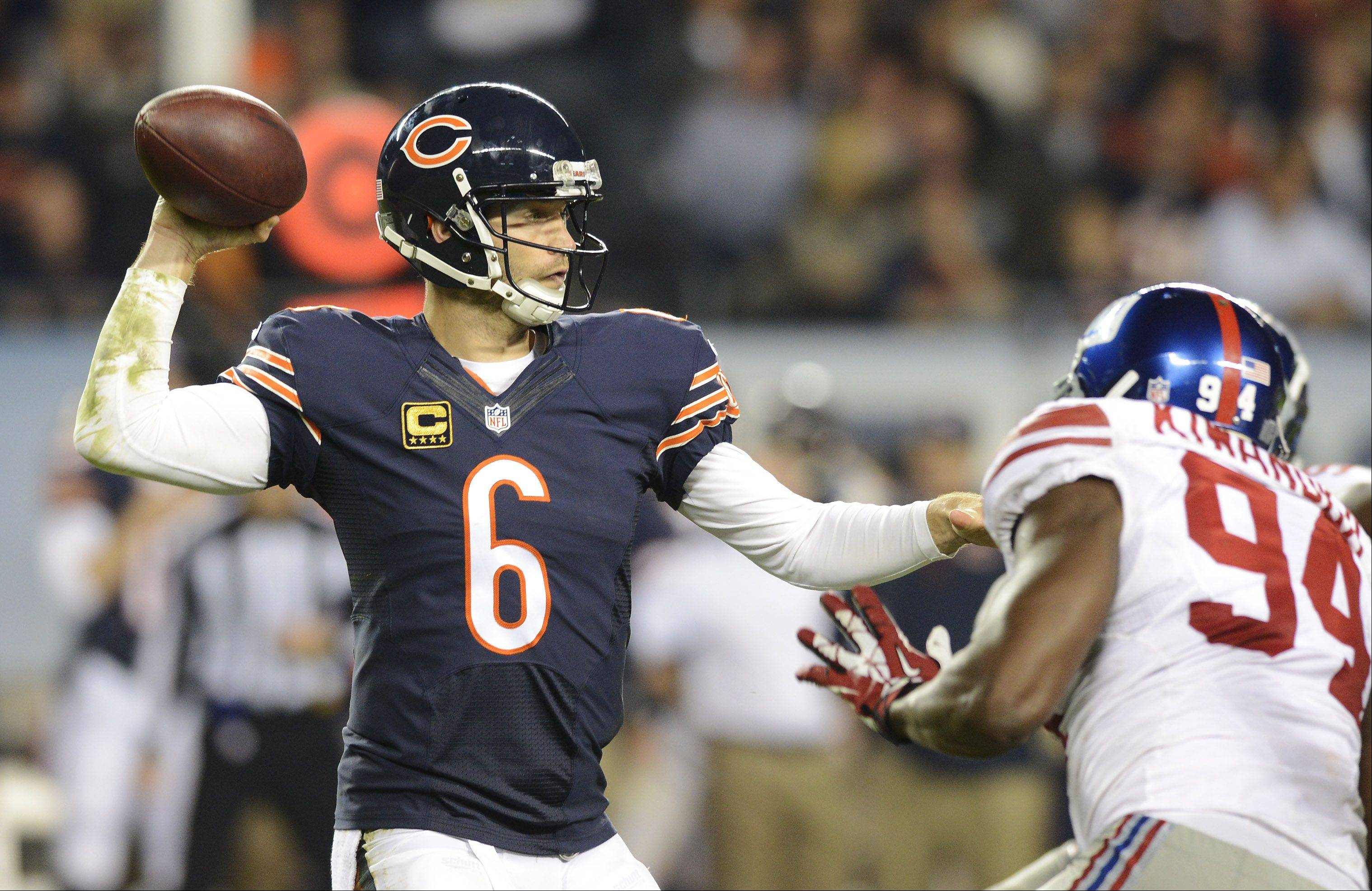 Jay Cutler throws a pass as Giants defensive end Mathias Kiwanuka closes during the Bears' victory on Oct. 10, 2013.