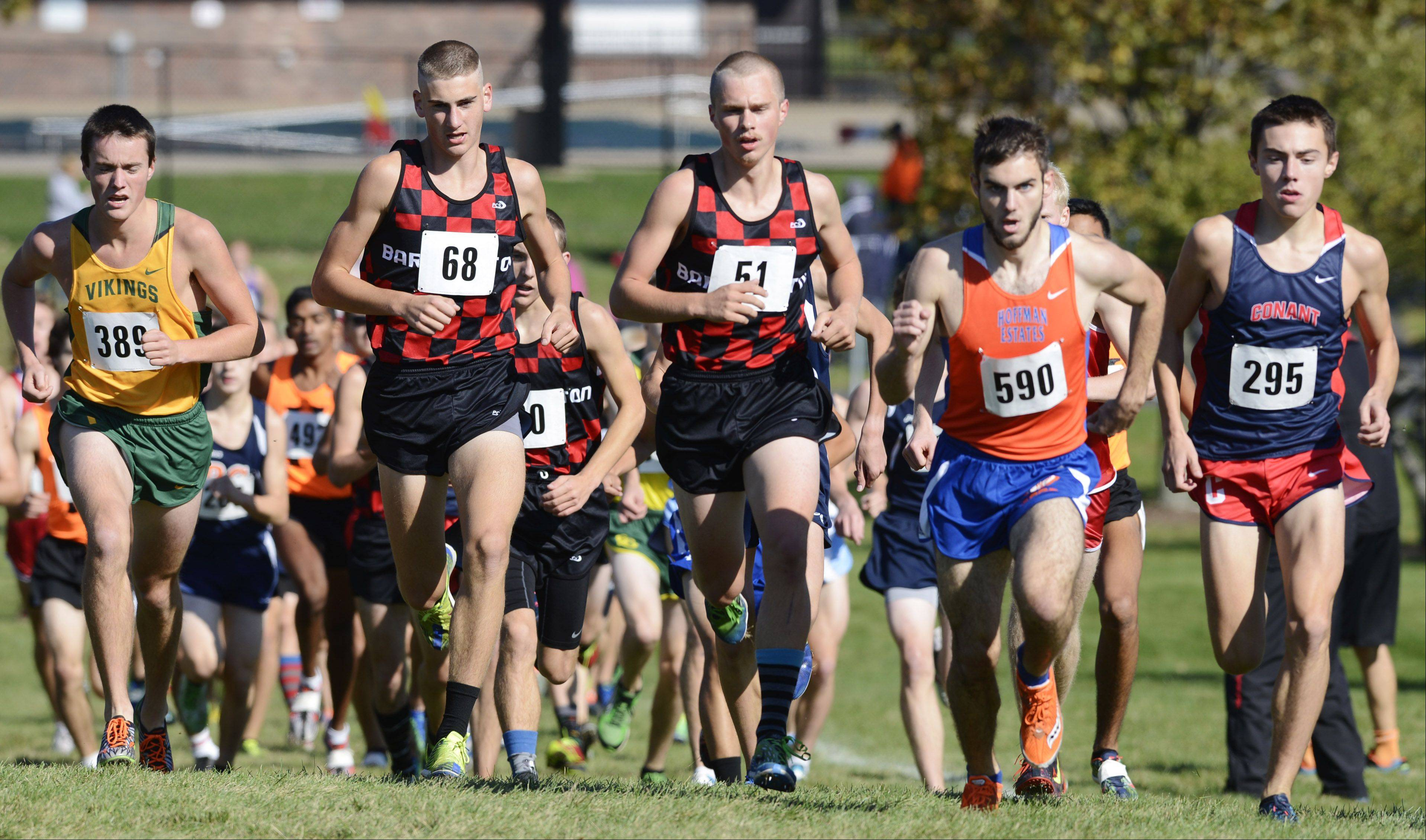 From left, Fremd's Harrison Winter, Barrington's Konrad Eiring and Jake Herb, Hoffman Estates's Billy Thomas and Conant's Zach Dale run side-by-side early during the Mid-Suburban League cross country meet at Willow Stream Park in Buffalo Grove on Saturday.