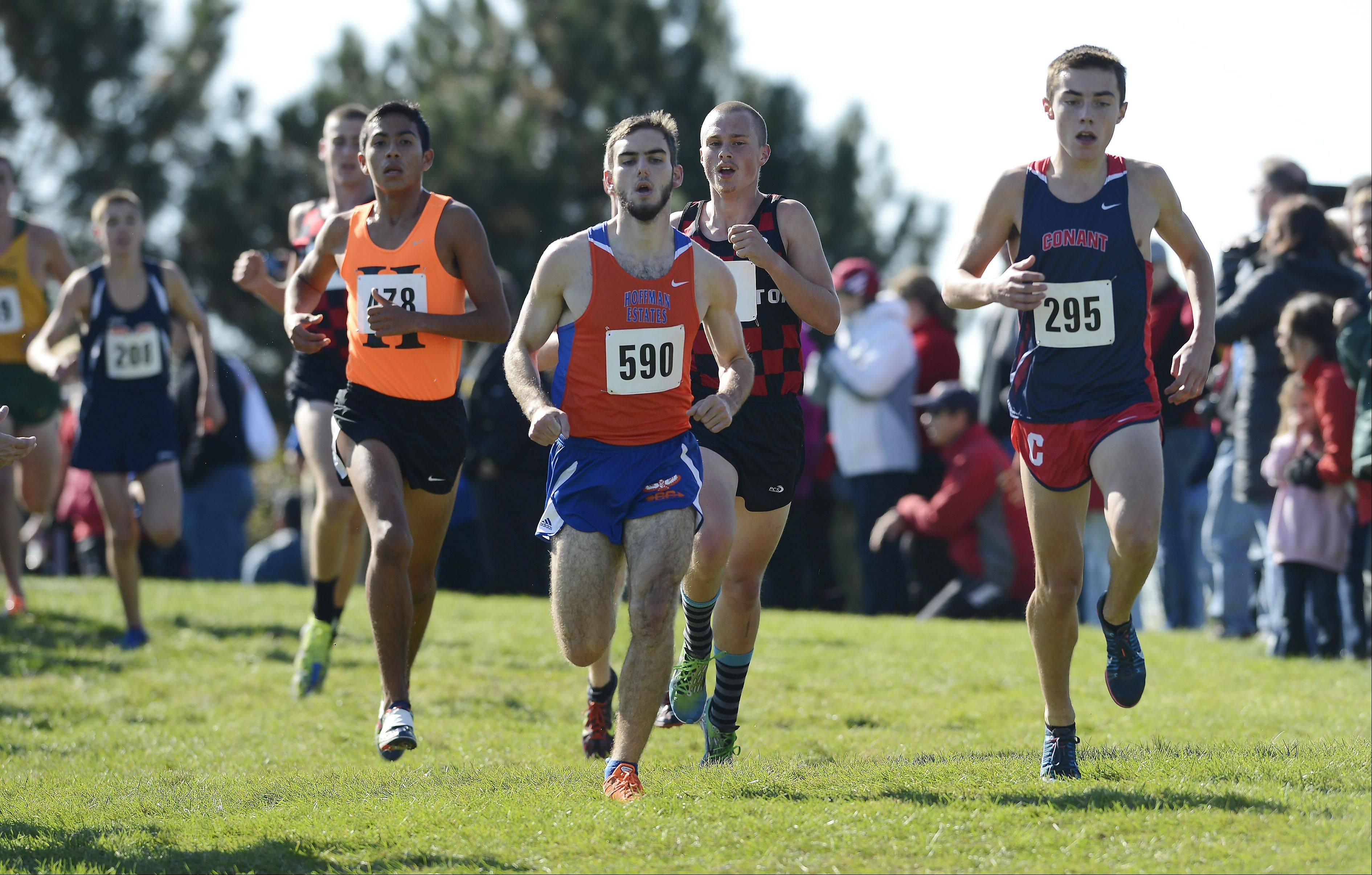 Conant's Zach Dale, right, has a slight lead on the front of the pack, including Hoffman Estates' Billy Thomas, left, during the Mid-Suburban League cross country meet at Willow Stream Park in Buffalo Grove on Saturday.