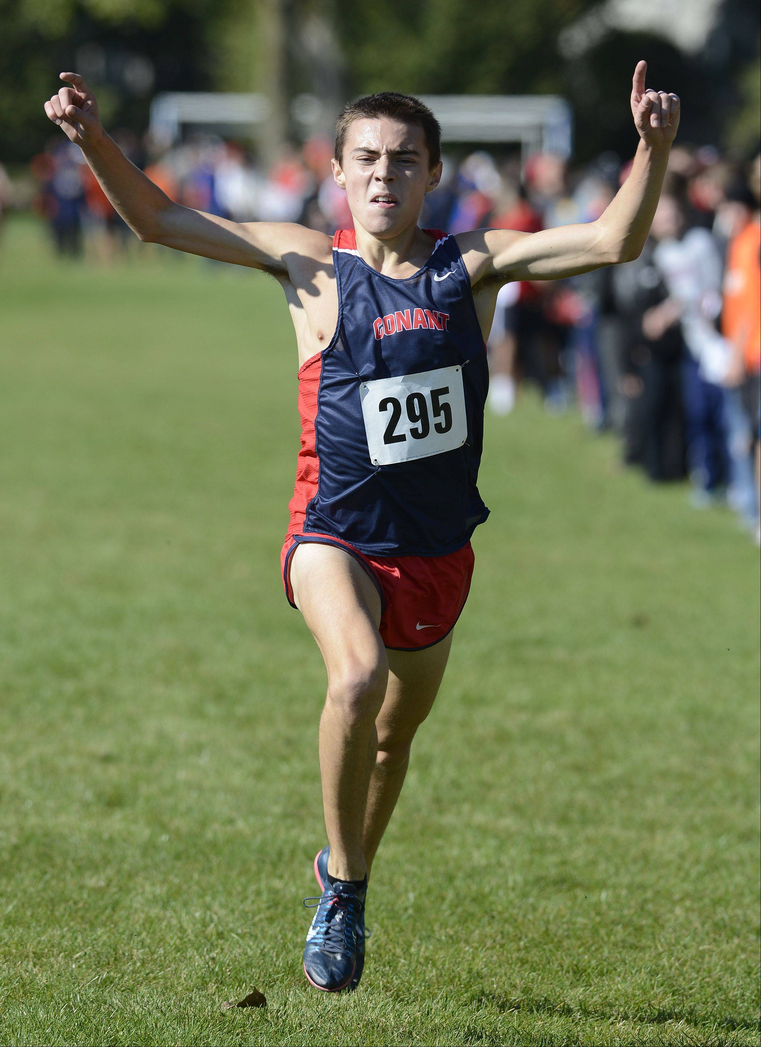 Conant's Zach Dale celebrates as he wins the boys race during the Mid-Suburban League cross country meet at Willow Stream Park in Buffalo Grove on Saturday.