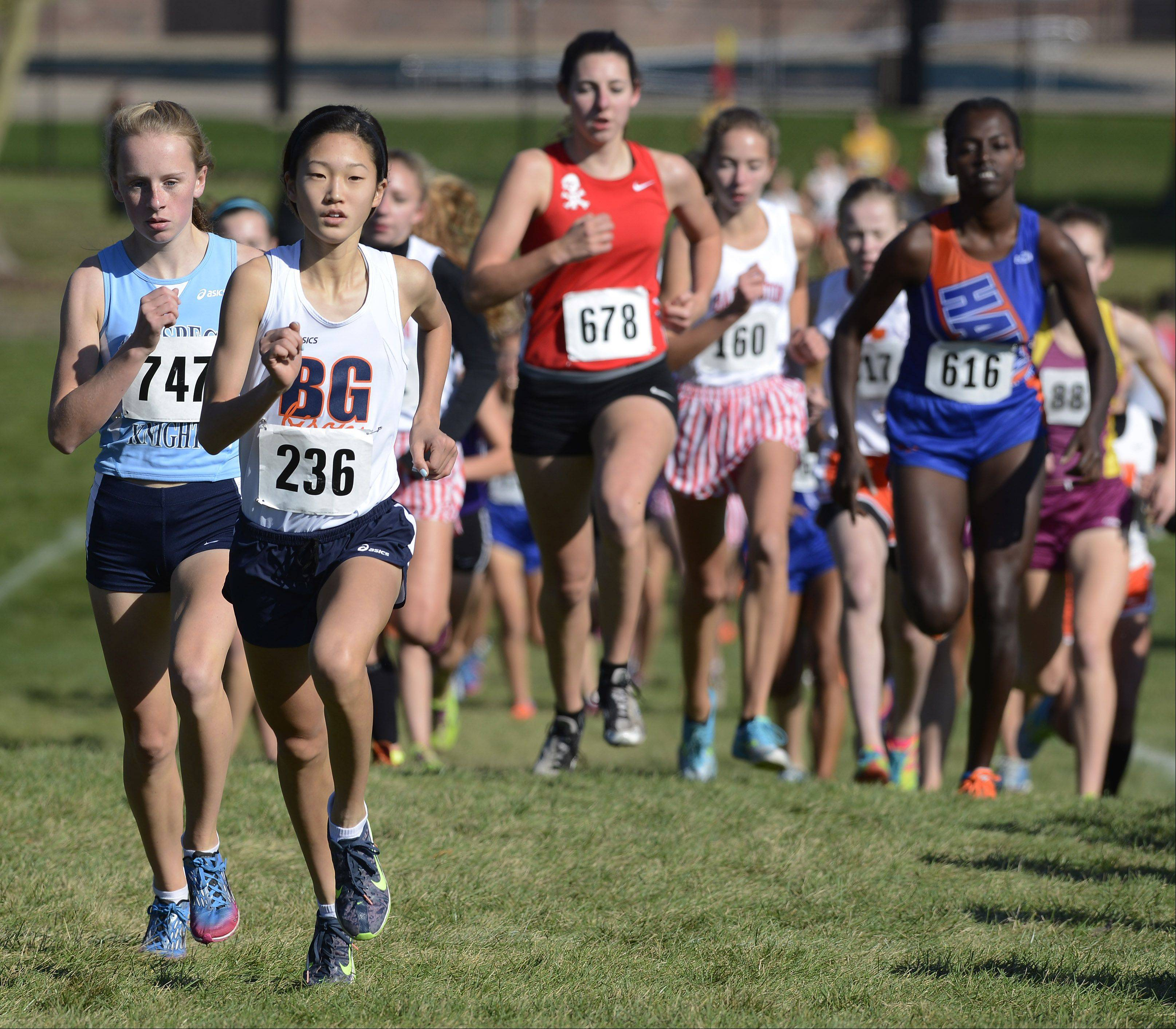 JOE LEWNARD/jlewnard@dailyherald.comBuffalo Grove's Kaitlyn Ko, who went on to win the race, has an early lead during the Mid-Suburban League cross country meet at Willow Stream Park in Buffalo Grove Saturday. At left is Prospect's Brooke Wilson, who finished 12th.