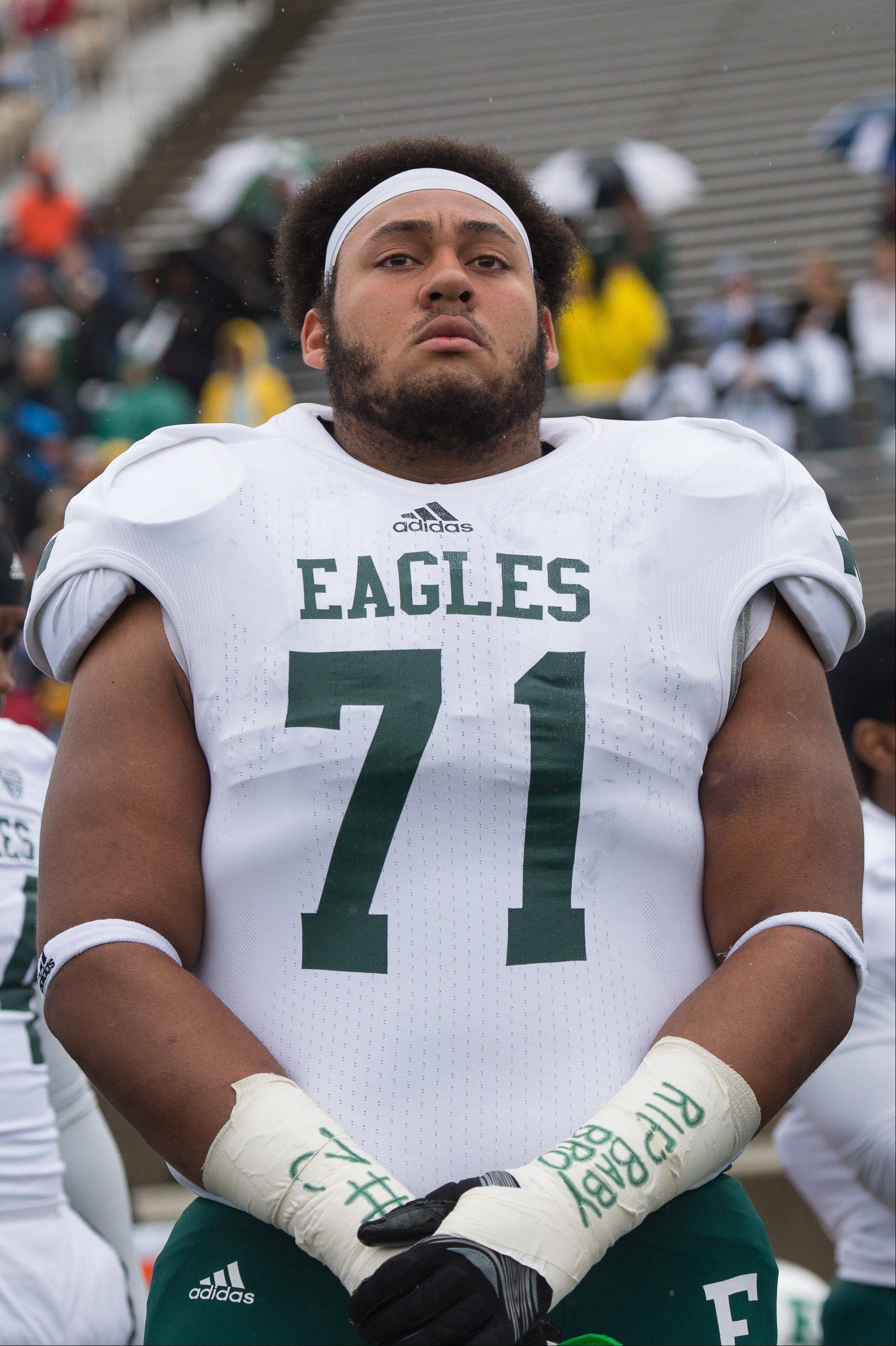 Eastern Michigan University's Darien Terrell looks out on to the field after a moment of silence to honor Demarius Reed.