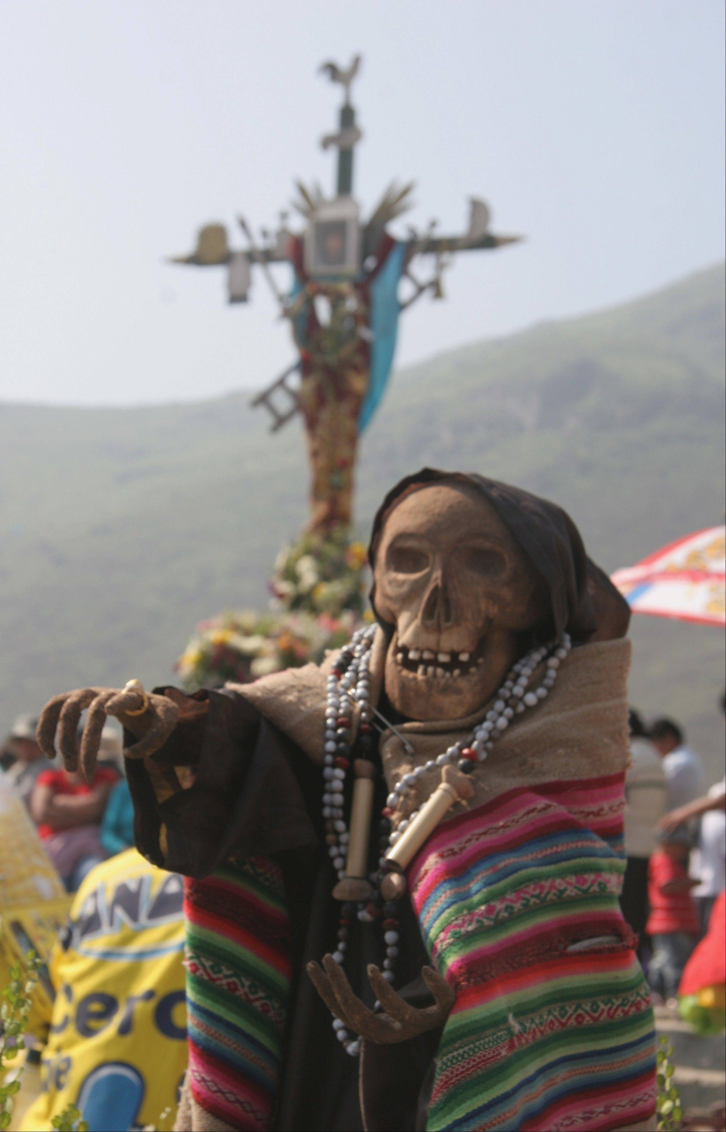 A procession honors Santa Muerte, the saint of death, during last year's Day of the Dead festival at the Cemetery of Nueva Esperanza in Villa Maria del Triunfo in Lima, Peru.