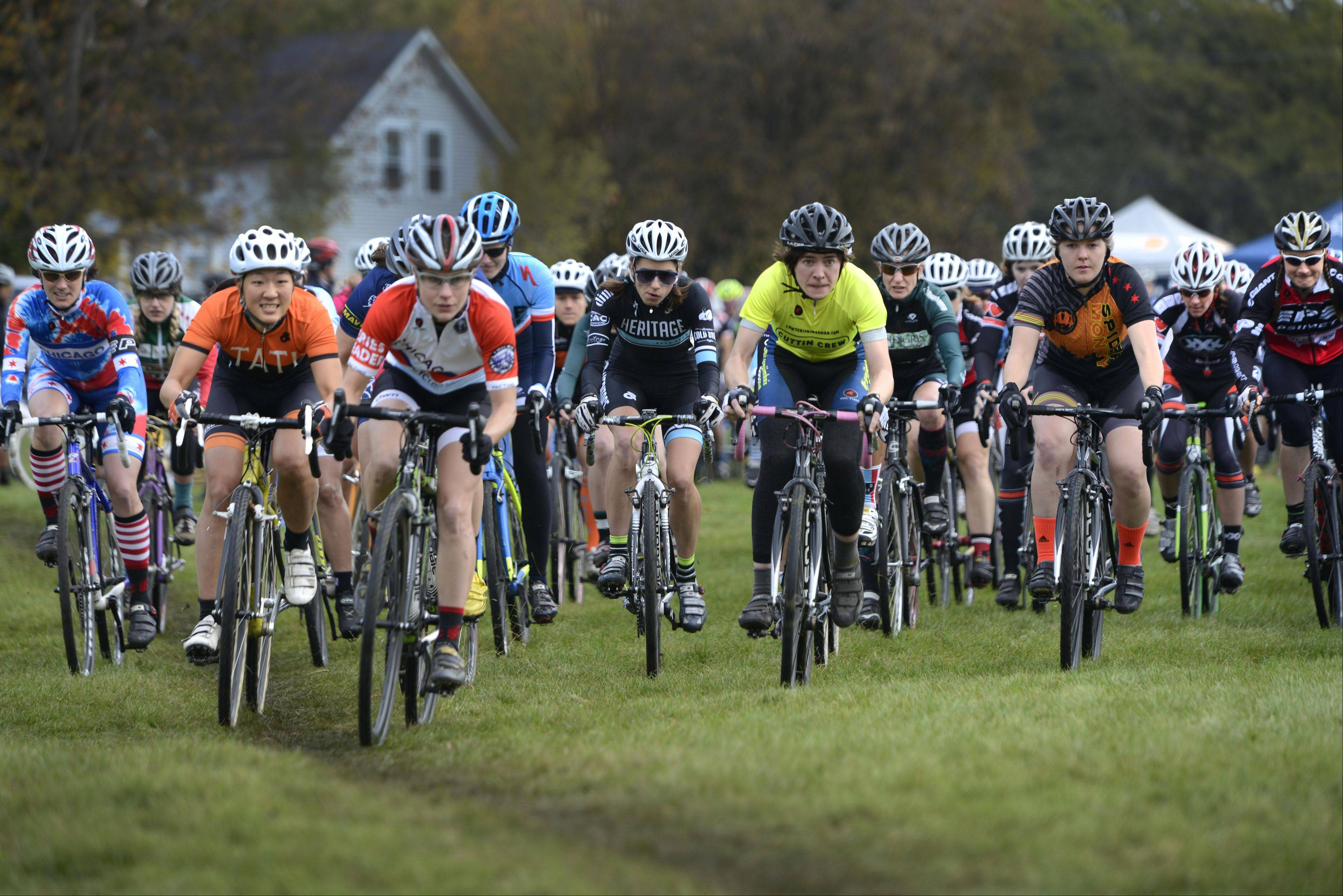 Racers pedal hard for the first corner Sunday during the Chicago Cyclocross Cup bicycle races at Carpenter Park in Carpentersville. More than 600 racers, most from Illinois, competed. There was also a beer garden, food, live entertainment and children�s activities.