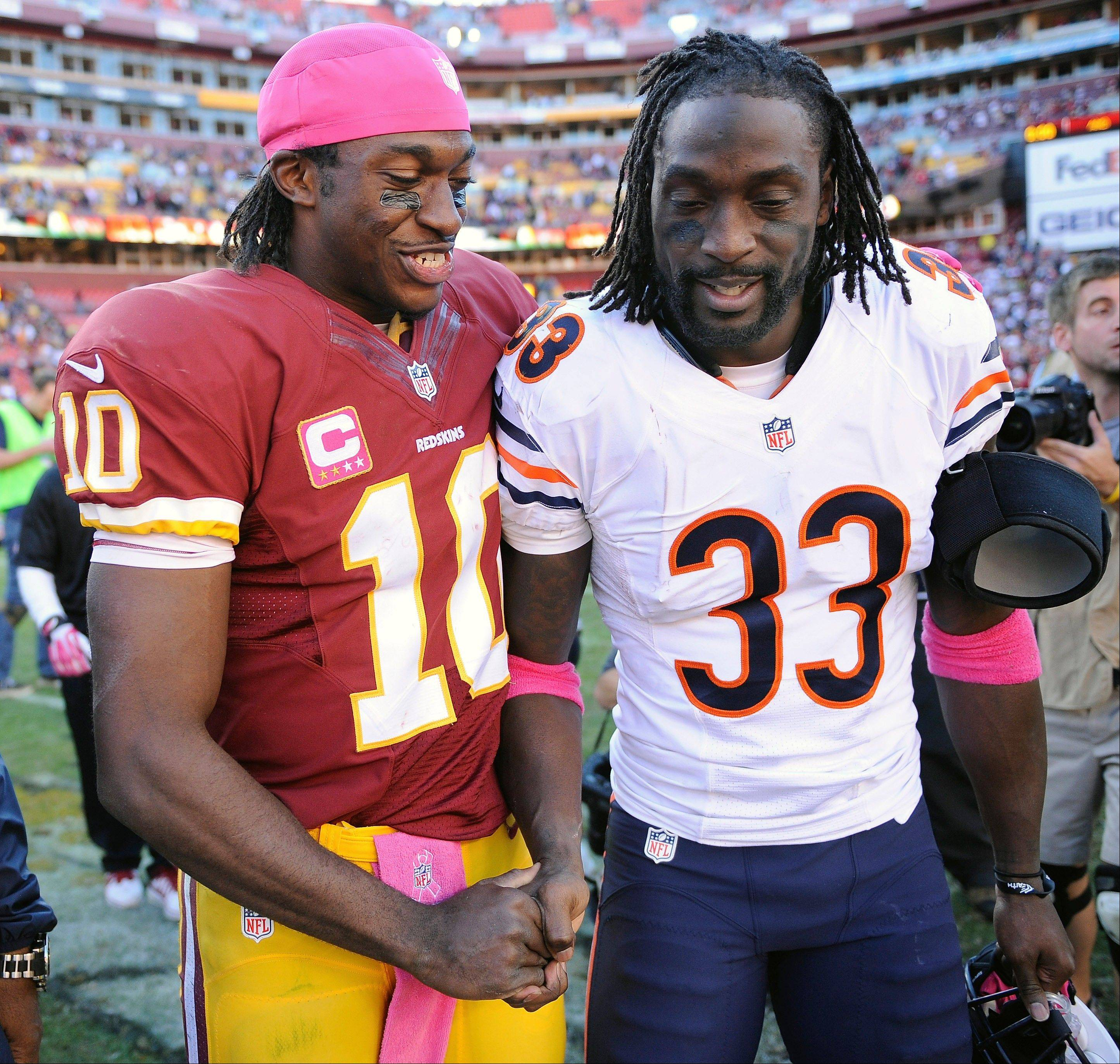 Washington quarterback Robert Griffin III, left, greets Chicago Bears cornerback Charles Tillman after Washington defeated the Bears 45-41.