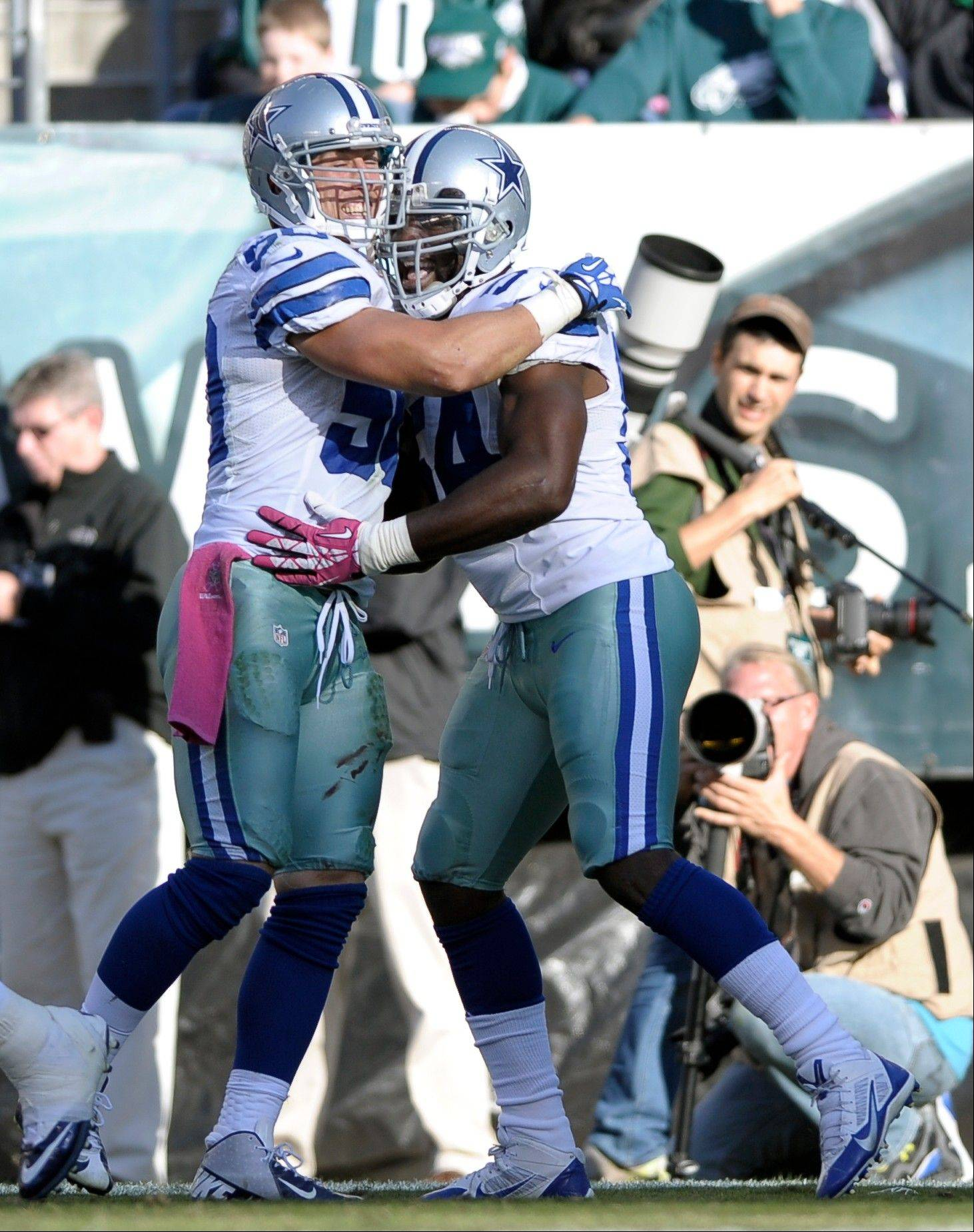 Dallas Cowboys outside linebacker Bruce Carter, right, celebrates with middle linebacker Sean Lee, left, after Carter intercepted a pass from Philadelphia Eagles quarterback Matt Barkley during the second half of an NFL football game, Sunday, Oct. 20, 2013, in Philadelphia.