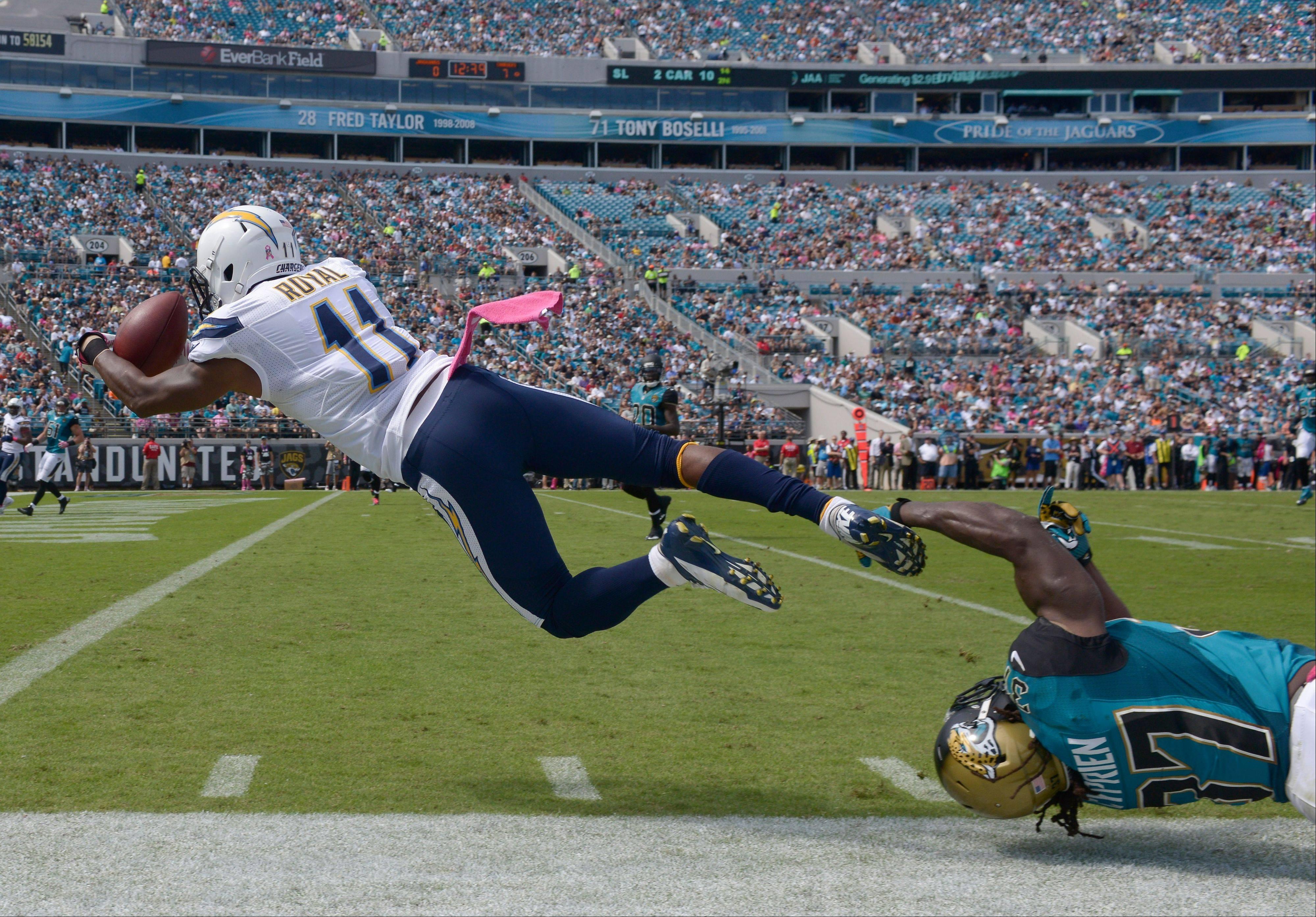 San Diego Chargers wide receiver Eddie Royal (11) catches a 27-yard pass for a touchdown as Jacksonville Jaguars strong safety Johnathan Cyprien, lower right, can�t stop him during the first half of an NFL football game in Jacksonville, Fla., Sunday, Oct. 20, 2013.