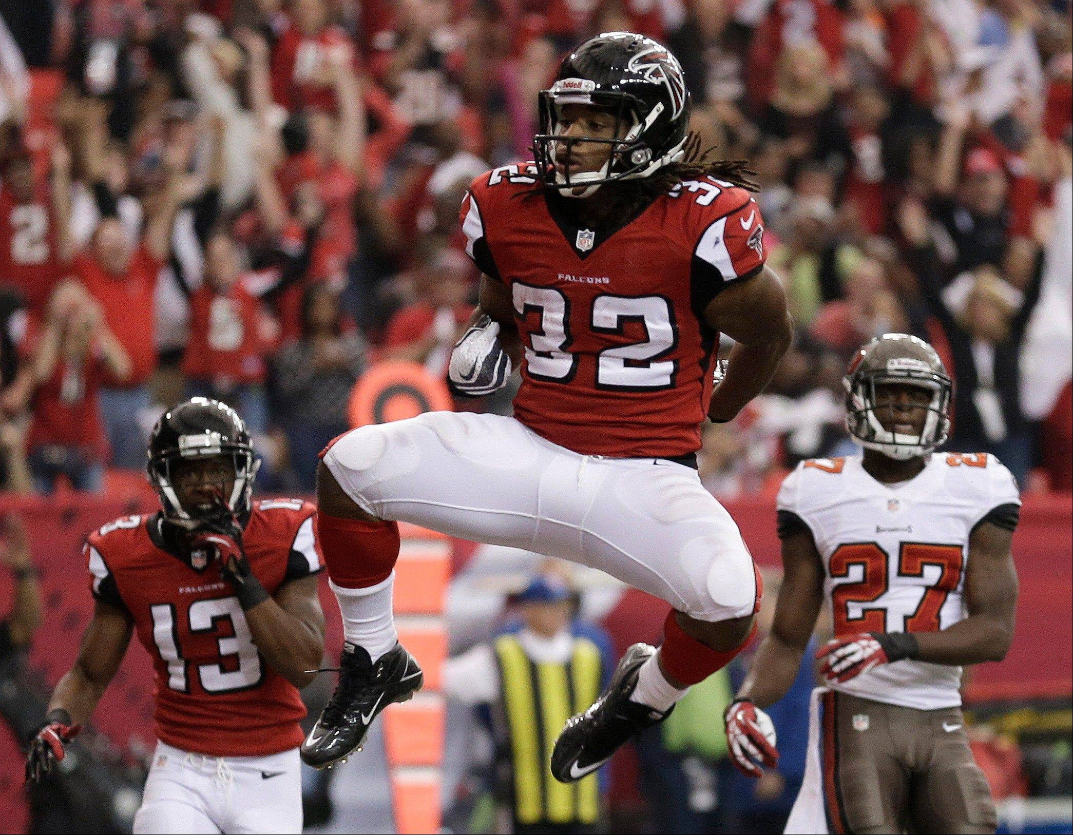 Atlanta Falcons running back Jacquizz Rodgers (32) celebrates his touchdown against the Tampa Bay Buccaneers during the second half of an NFL football game, Sunday, Oct. 20, 2013, in Atlanta.