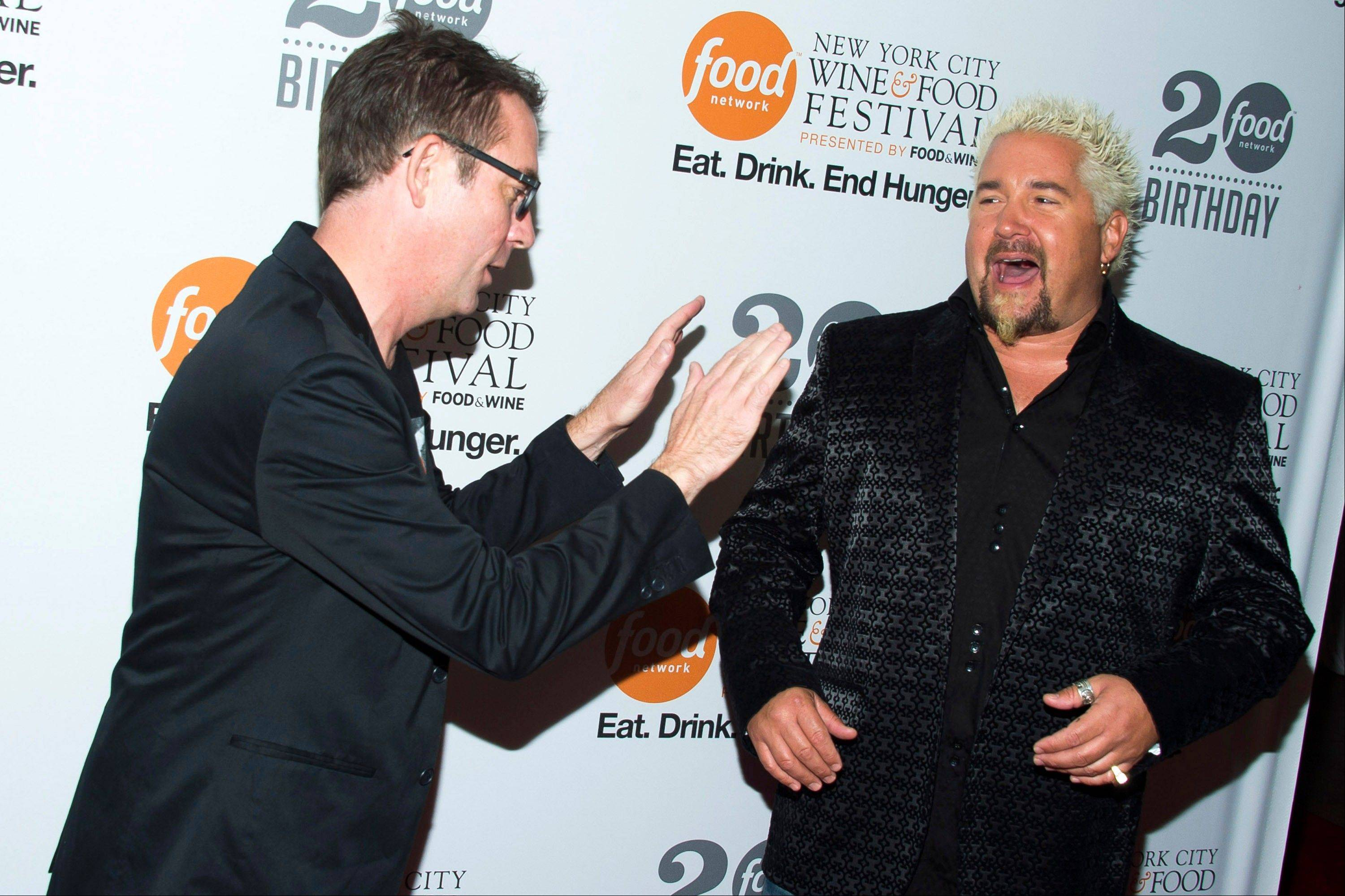 Ted Allen, left, and Guy Fieri attend the Food Network's 20th birthday party on Thursday in New York.
