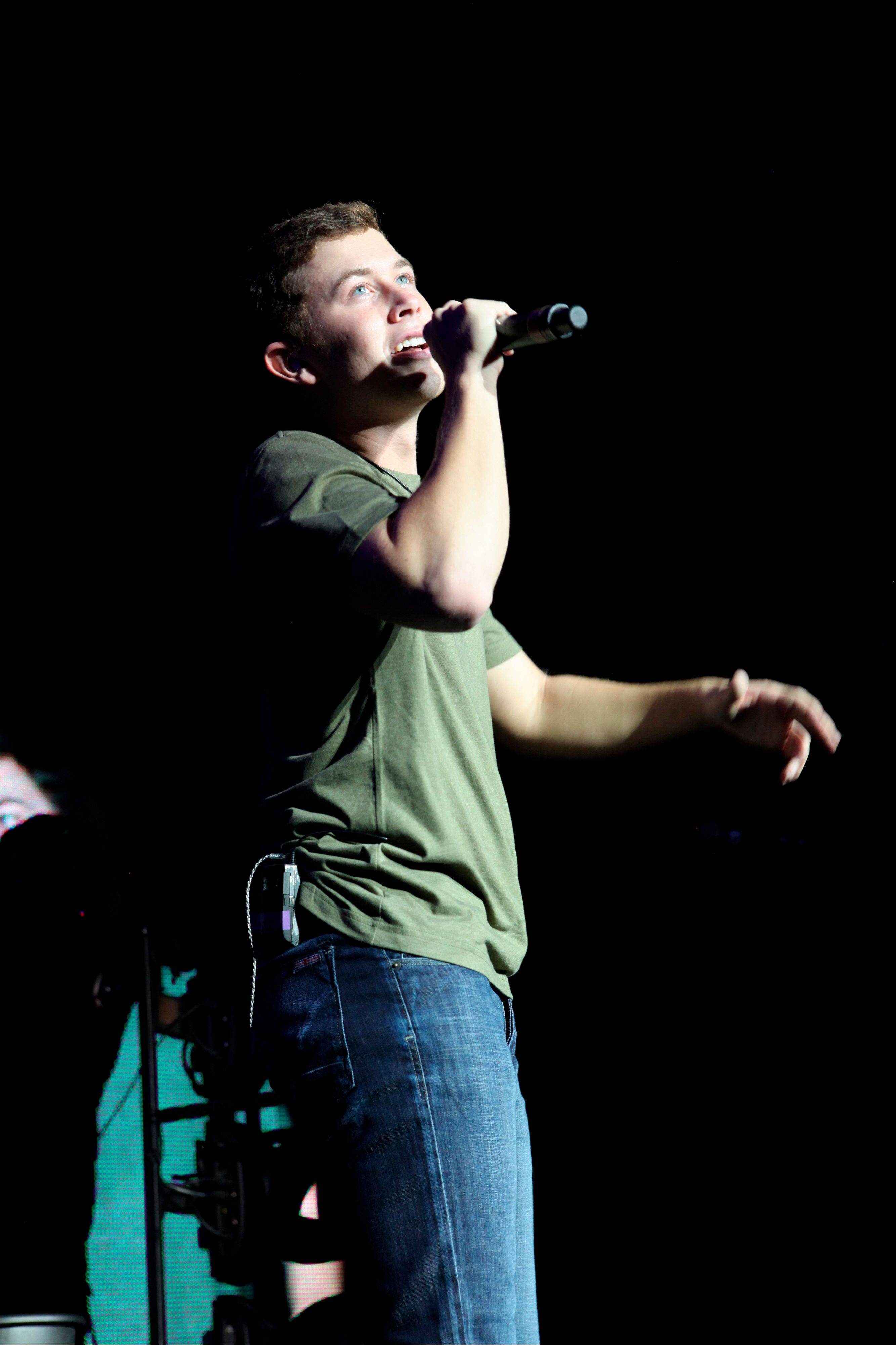 "Scotty McCreery performs at Aarons Amphitheater in Atlanta. McCreery rode a wave of success after winning the 2011 season of ""American Idol,"" with his first record going platinum and winning several new artist awards. But with his sophomore album, ""See You Tonight,"" McCreery says his career is now in his hands alone."