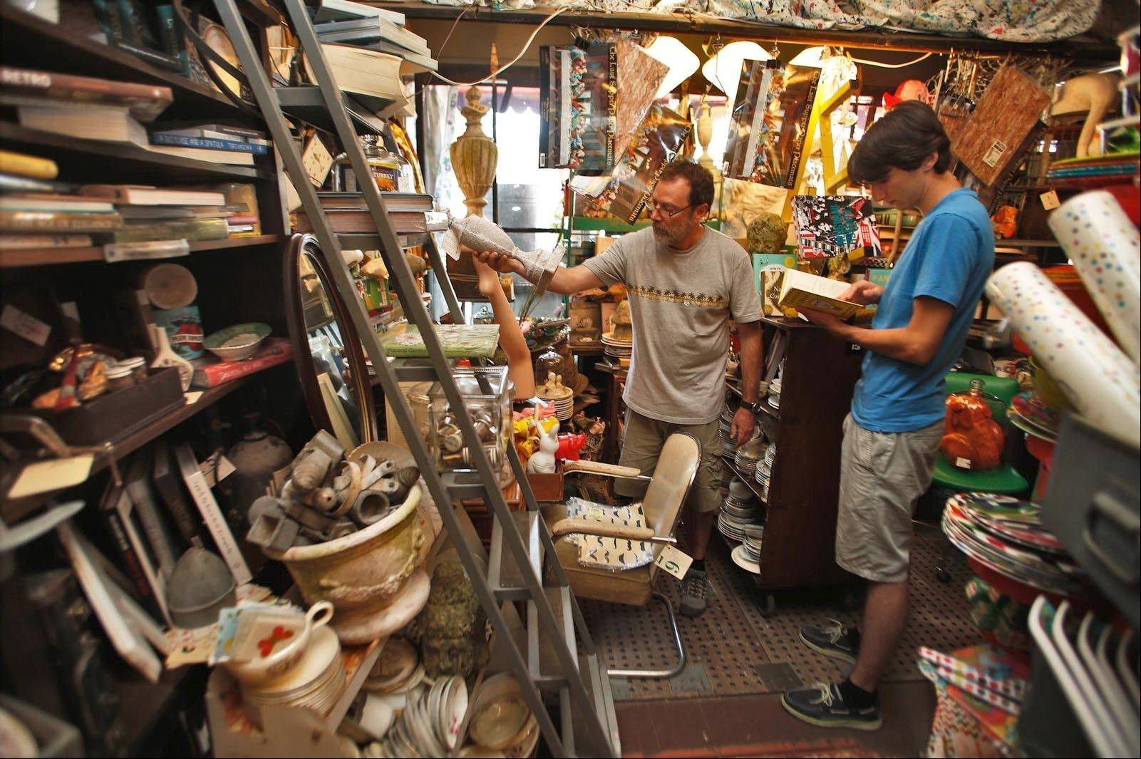 Norbert Schiller and his son, Tamer Schiller, look for items for Tamer to display in his dorm room.