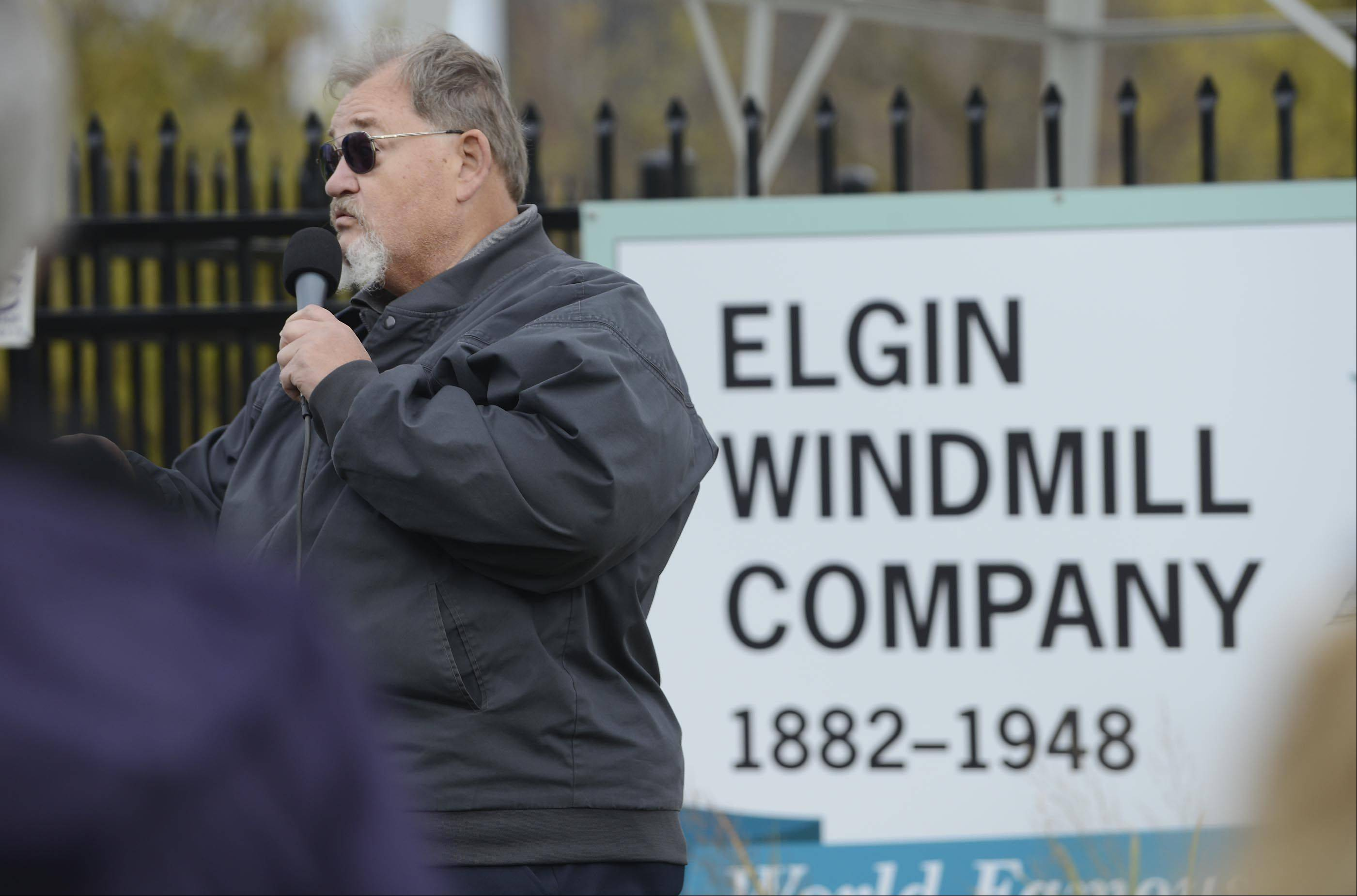 Maurice Dyer, an Elgin Historical Society board member, speaks Sunday at the dedication of a 91-year-old windmill at Foundry Park in Elgin. The windmill is a relic from the Elgin Wind, Power and Pump Co., which closed in 1948. It was donated to the Elgin Area Historical Society and refurbished by windmill expert Frank Engel.