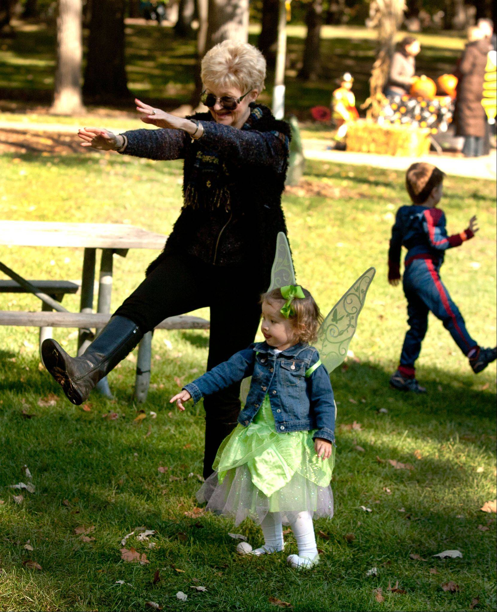 Susan Christensen, grandmother of Addison Dunne, 2, of Glen Ellyn, dance together during a Boo Bash at Lake Ellyn Park in Glen Ellyn.