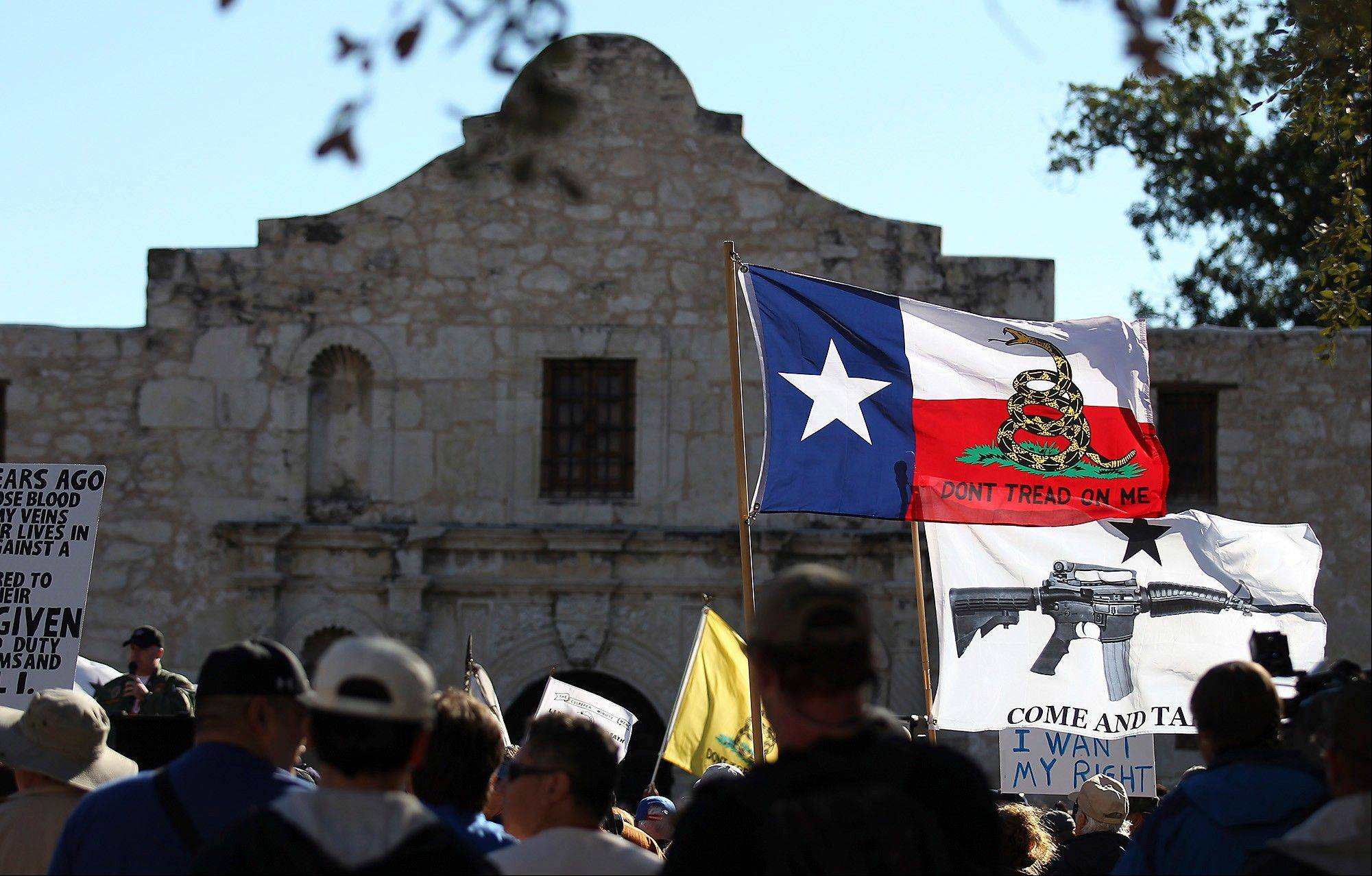 "Flags fly at the ""Come And Take It San Antonio"" rally on Saturday. The event was intended to draw attention to a right Texans already have -- to carry long arms publicly so long as they don't do it in a menacing manner."