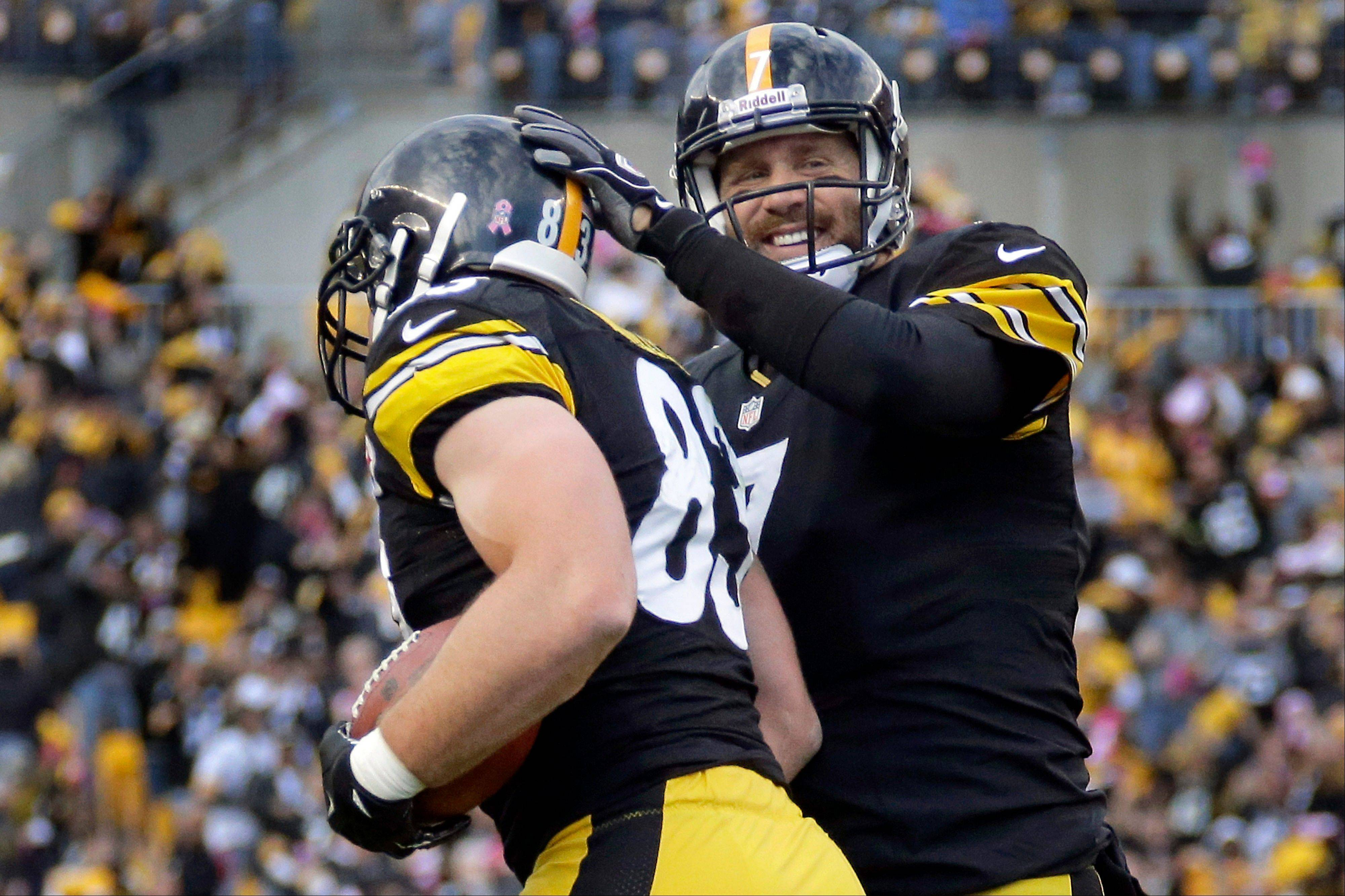 Pittsburgh Steelers quarterback Ben Roethlisberger, right, greets tight end Heath Miller after Miller caught Roethlisberger's pass for a touchdown in the first quarter of an NFL football game against the Baltimore Ravens in Pittsburgh on Sunday, Oct 20, 2013.