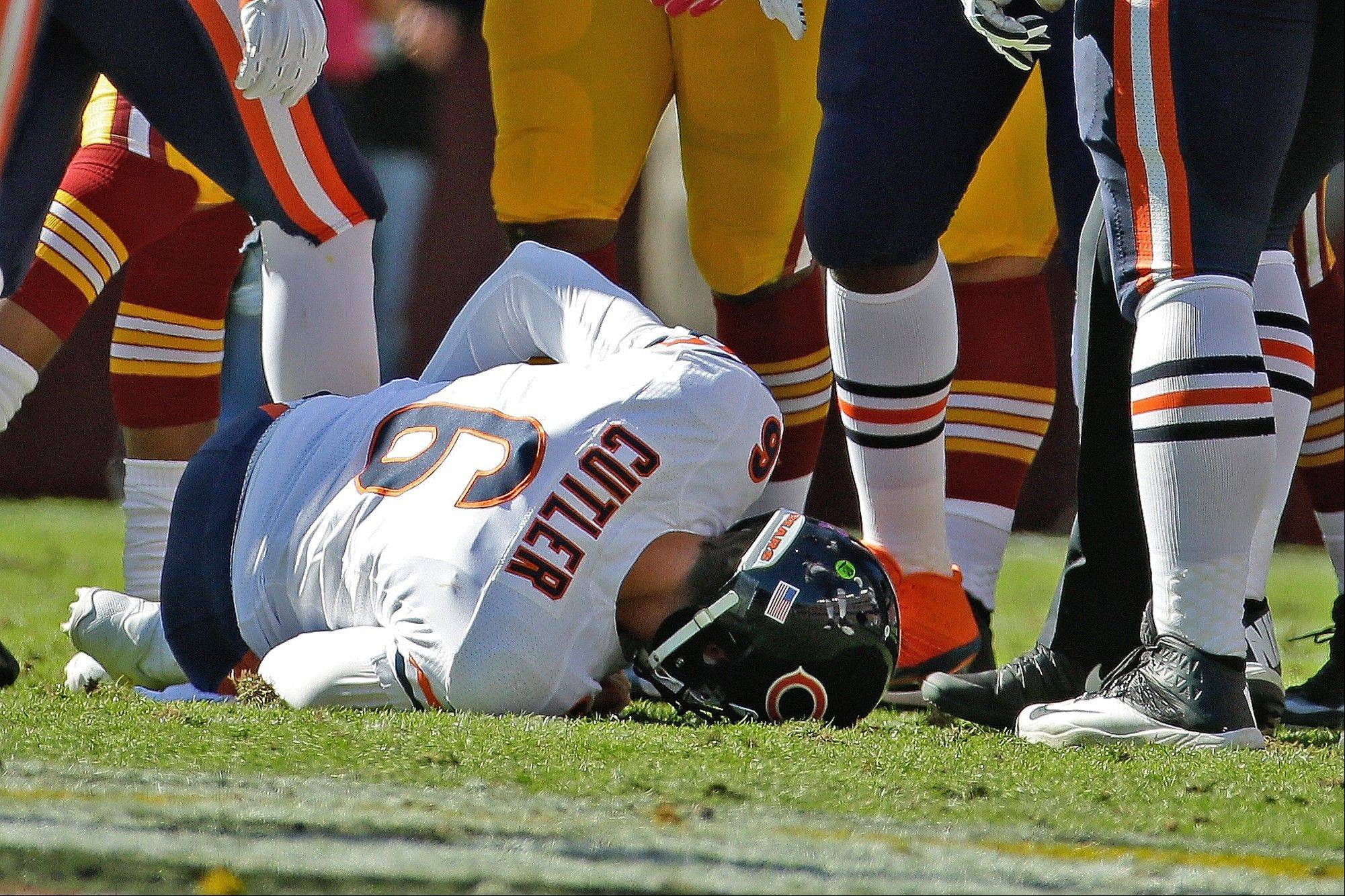 Bears quarterback Jay Cutler lies on the field after being injured in a sack by Washington defensive end Chris Baker during the first half of a NFL football game in Landover, Md., Sunday, Oct. 20, 2013.