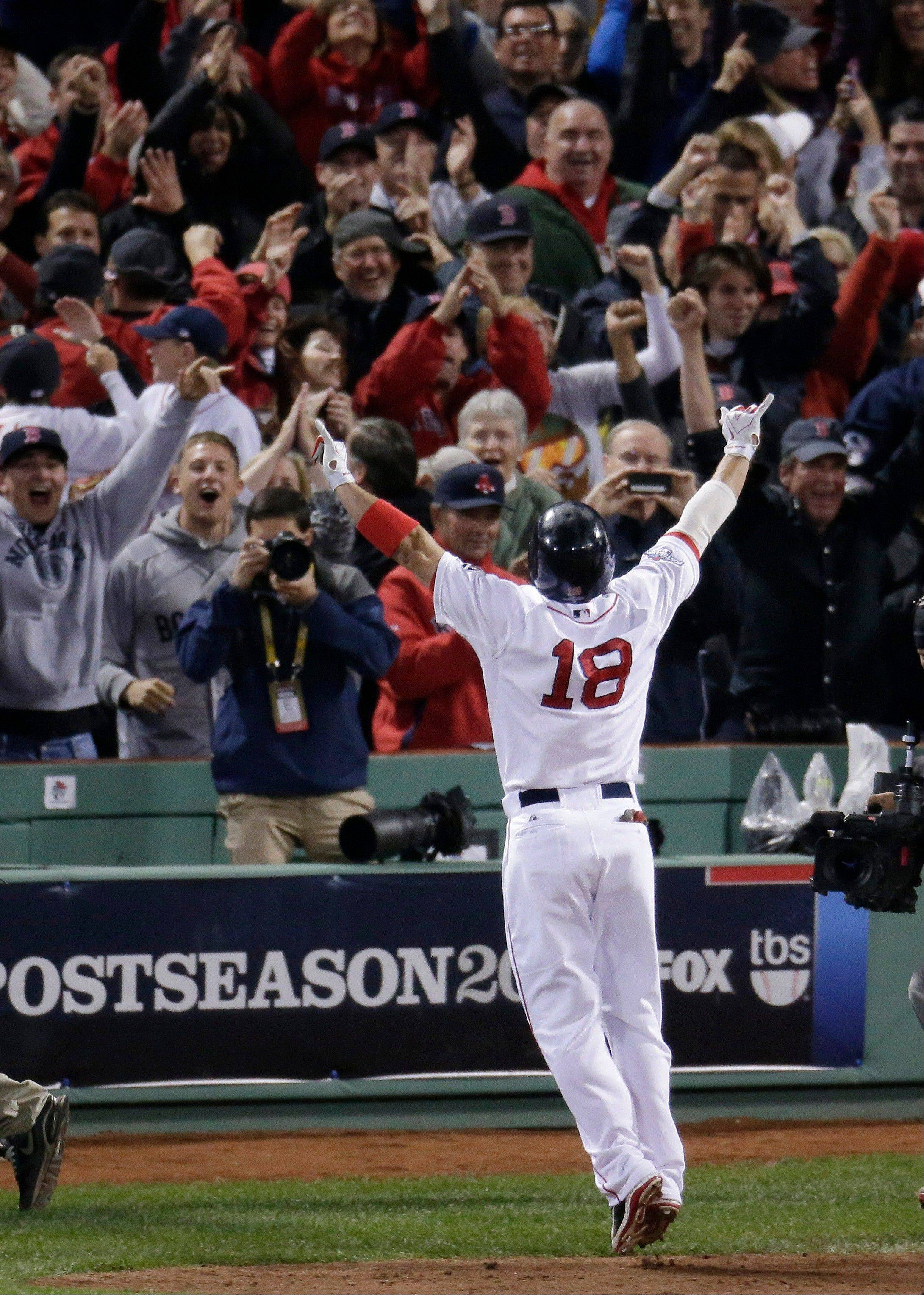 Boston Red Sox's Shane Victorino (18) celebrates his grand slam in front of fans in the seventh inning during Game 6 of the American League baseball championship series.