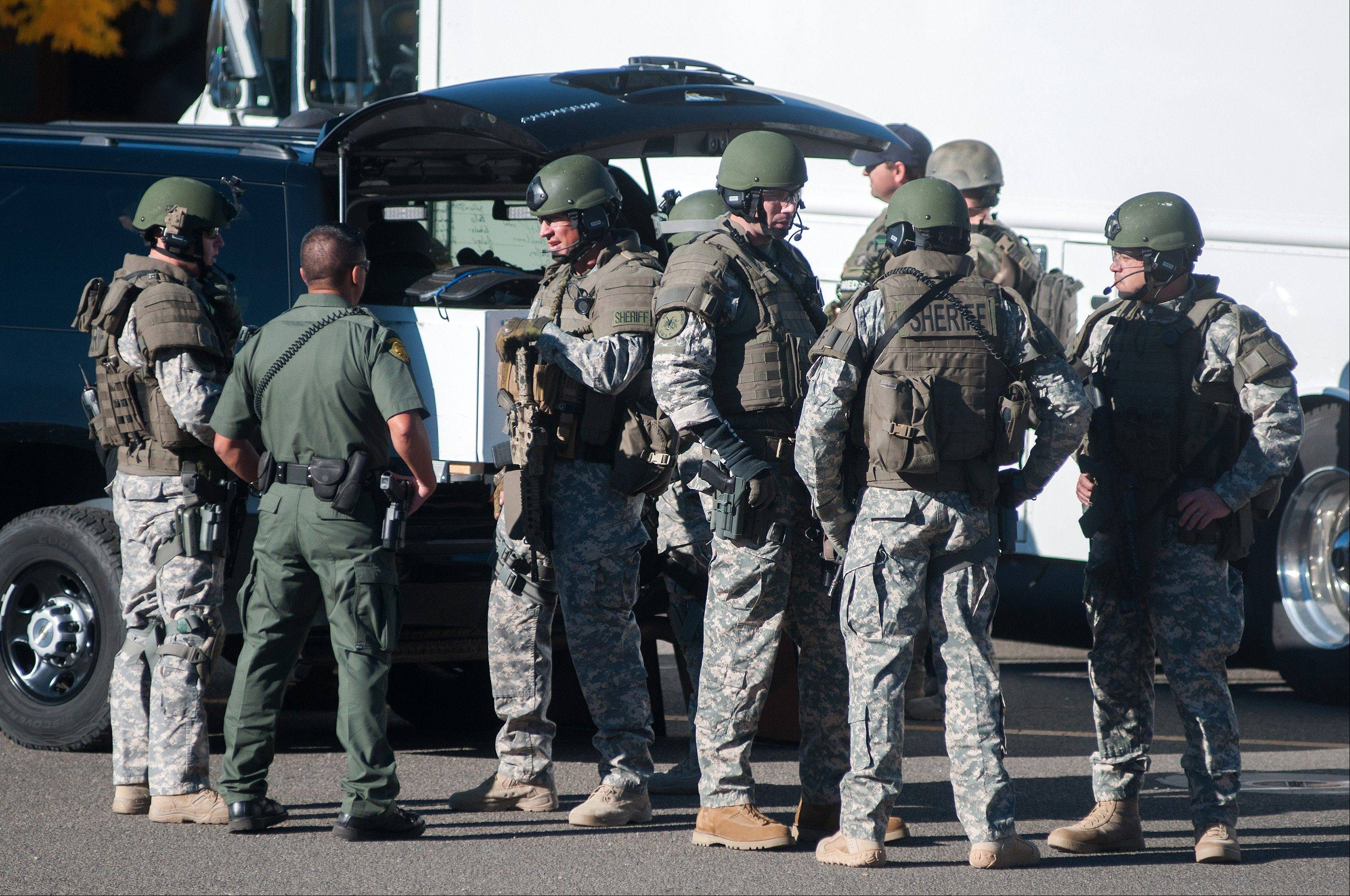 Swat team members secure the scene near Sparks Middle School in Sparks, Nev., after a shooting there on Monday.