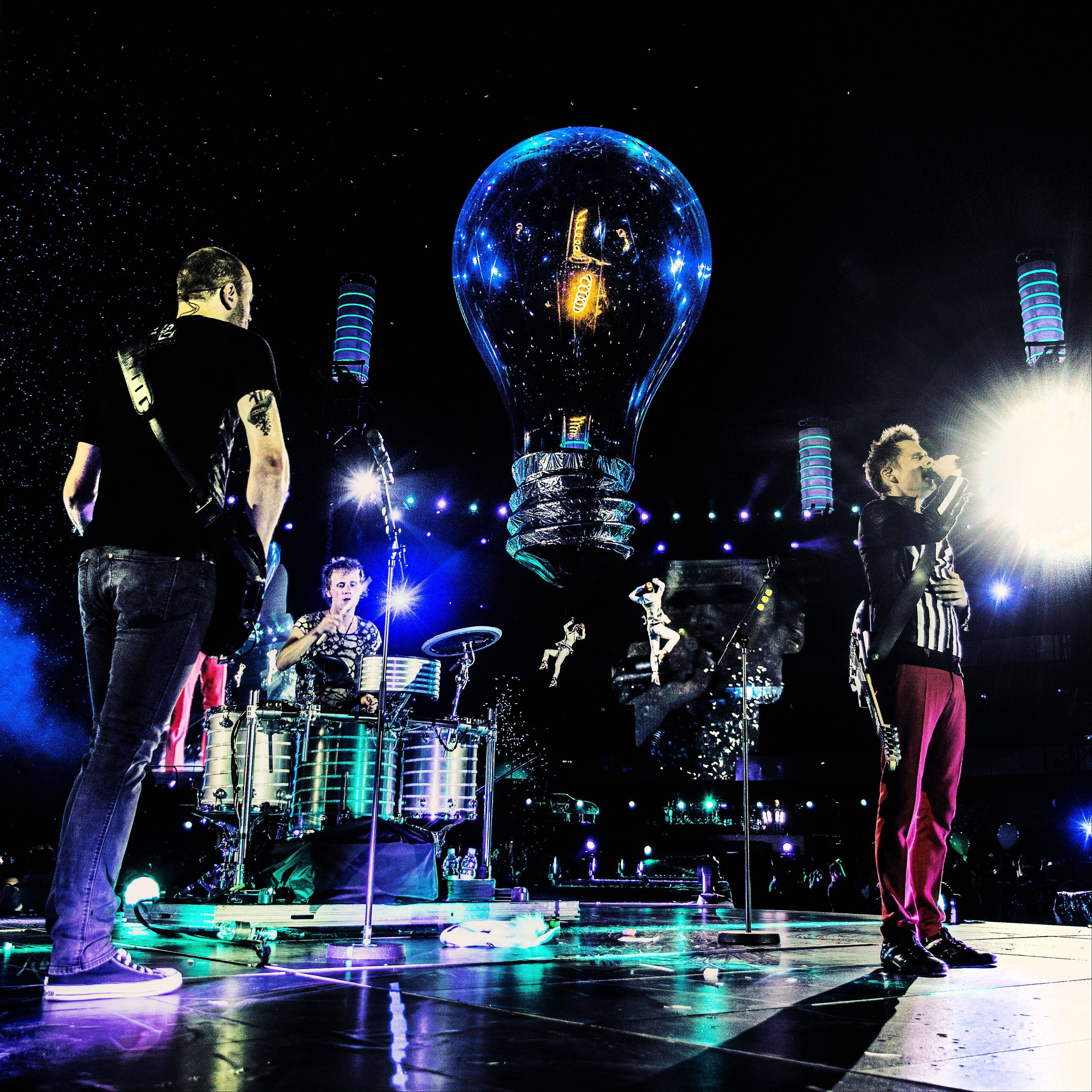 "Muse performing in their 4K Ultra High Definition concert film, ""Muse - Live at Rome Olympic Stadium,"" in July 2013. Following advance screenings, the film will be released in over 700 cinemas in 40 countries for limited screenings from Nov. 6, 2013."