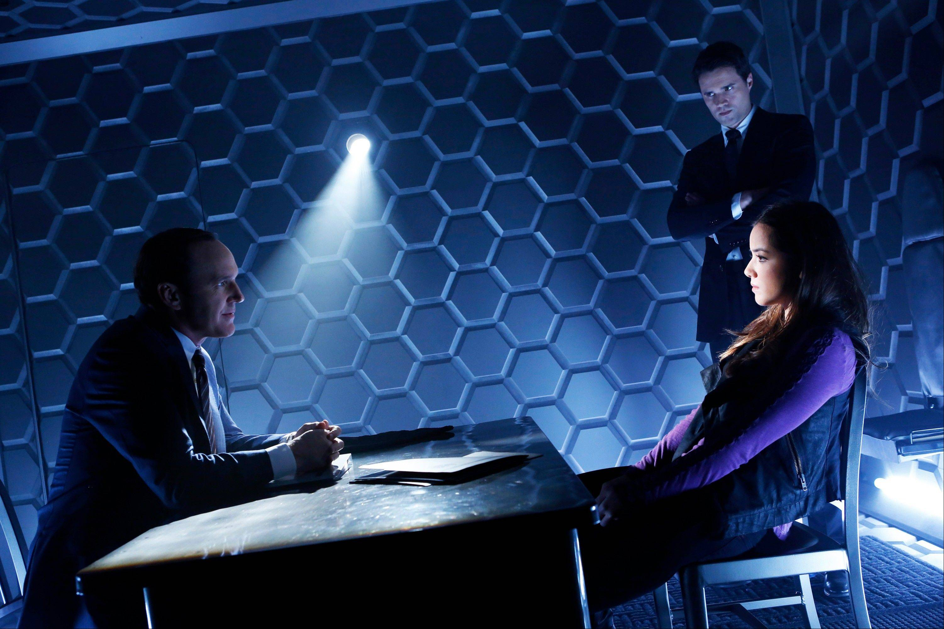 "Clark Gregg, left, stars with Brett Dalton, and Chloe Bennet in ABC's ""Marvel's Agents of S.H.I.E.L.D."" ""This show depicts a world that I loved as a kid,"" Gregg says."