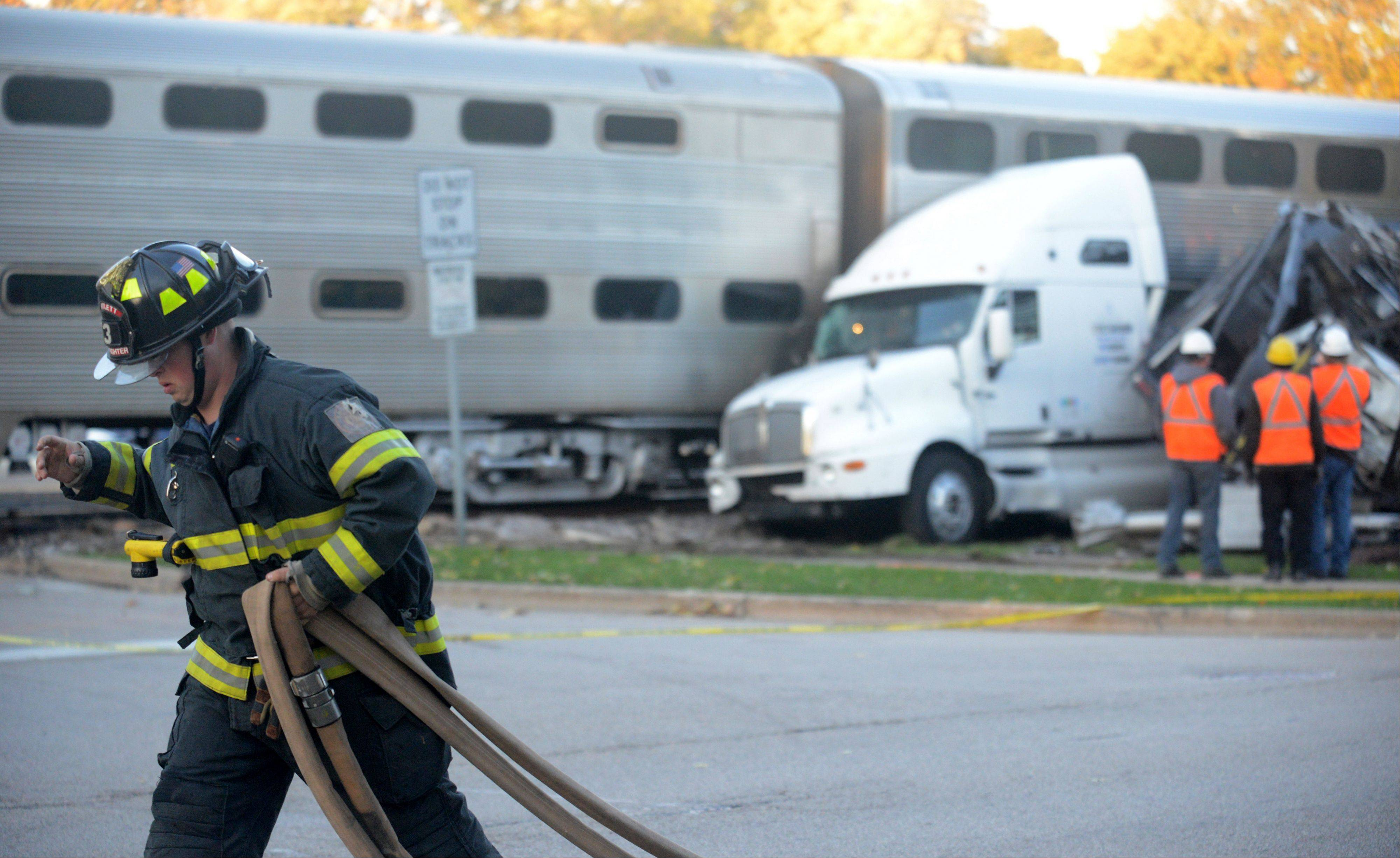 A Metra commuter train on Monday evening just west of the Bartlett train station struck a semitrailer truck loaded with automobiles. At least one coach of the train derailed in the process, and several automobiles parked along the tracks were damaged.