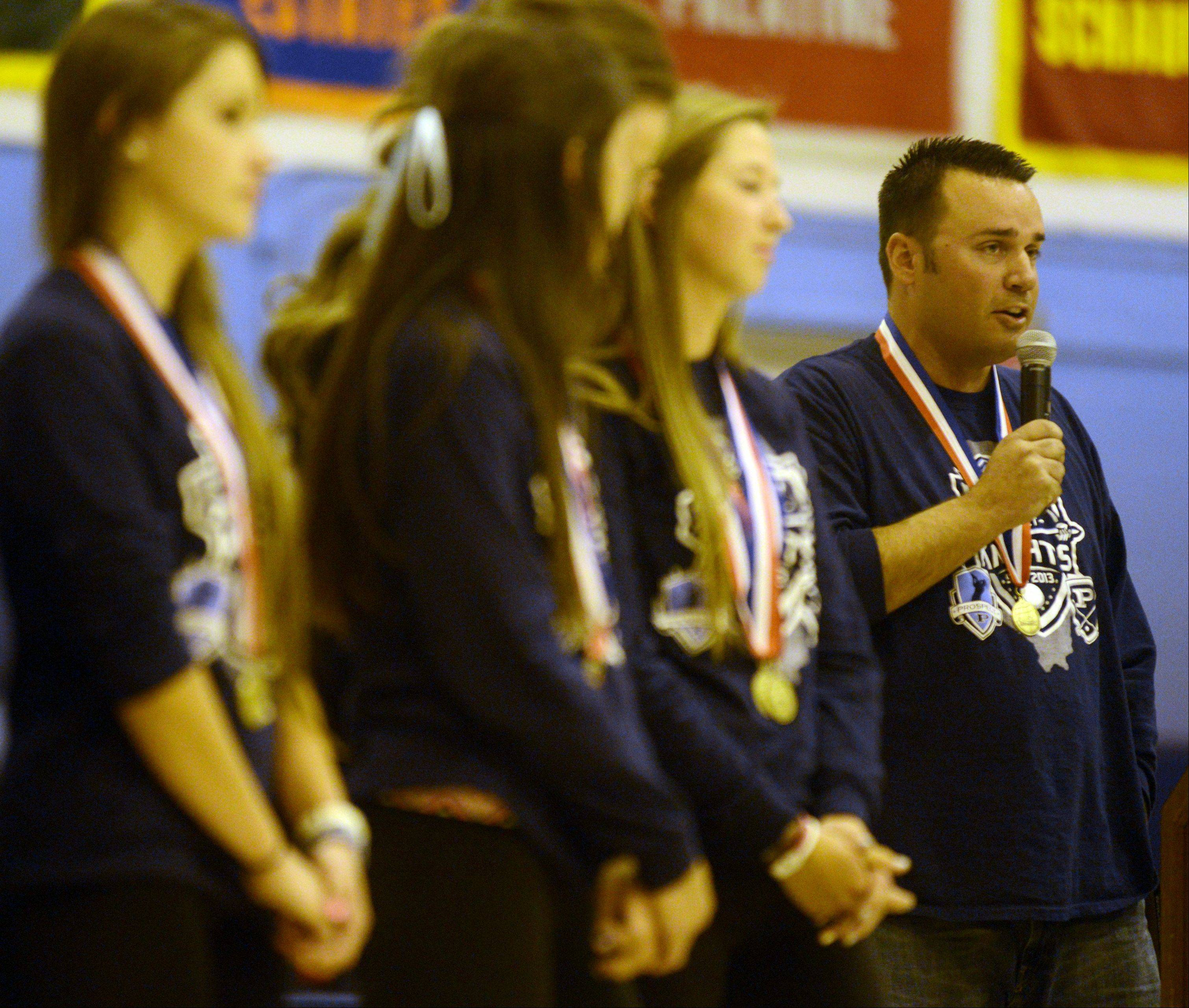 Prospect girls golf head coach Jim Hamann, right, introduces the members of his state championship team. The girls were honored during a pep rally Monday at Jean Walker Field House on the campus of Prospect High School.