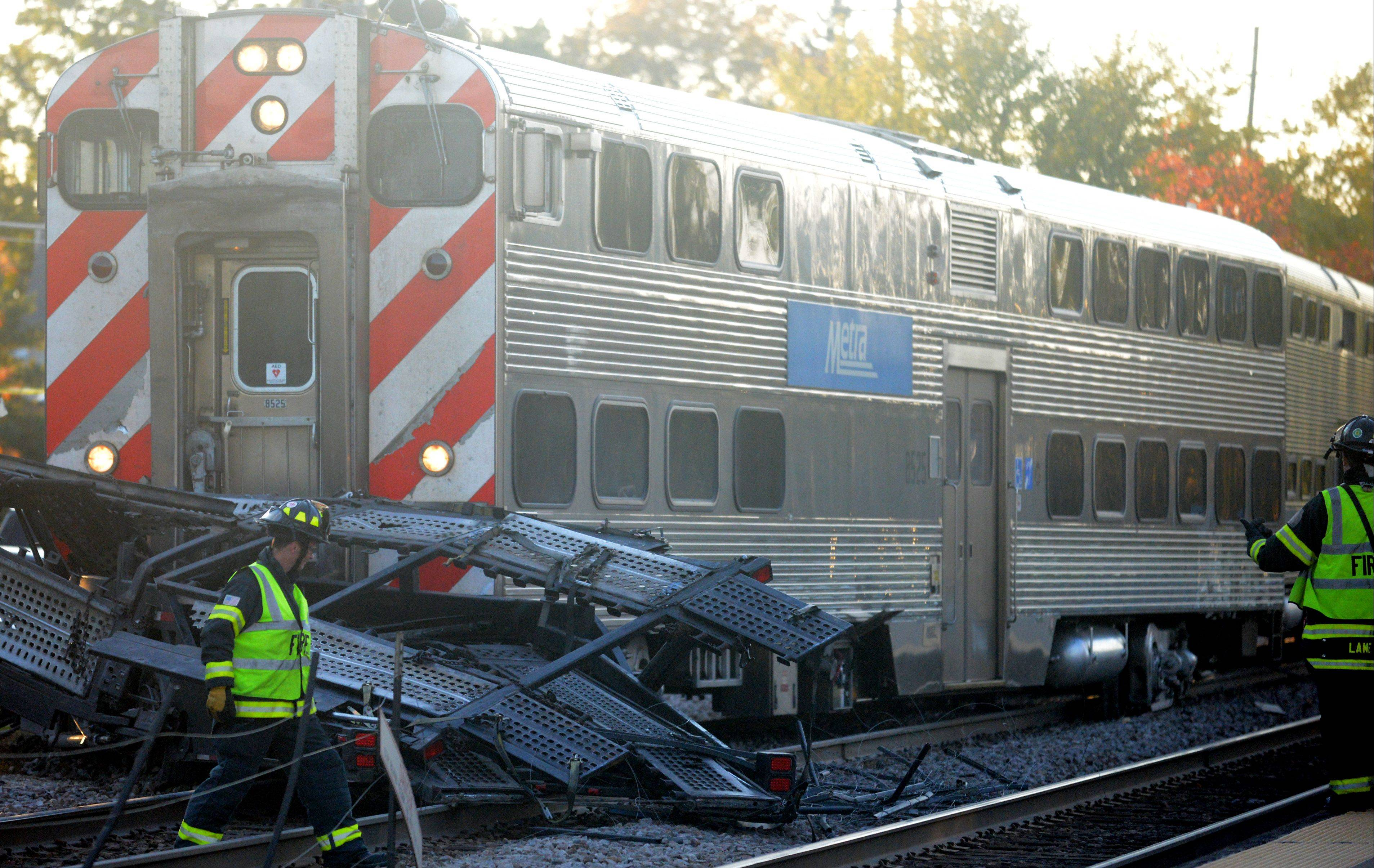 A Metra commuter train just west of the Bartlett train station struck a semitrailer truck loaded with automobiles on Monday evening. Two people were sent to the hospital.