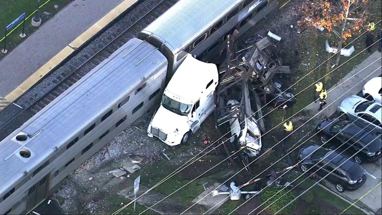 An aerial view of a collision between a Metra train and a semitrailer truck in Bartlett on Monday shows cars also totaled.