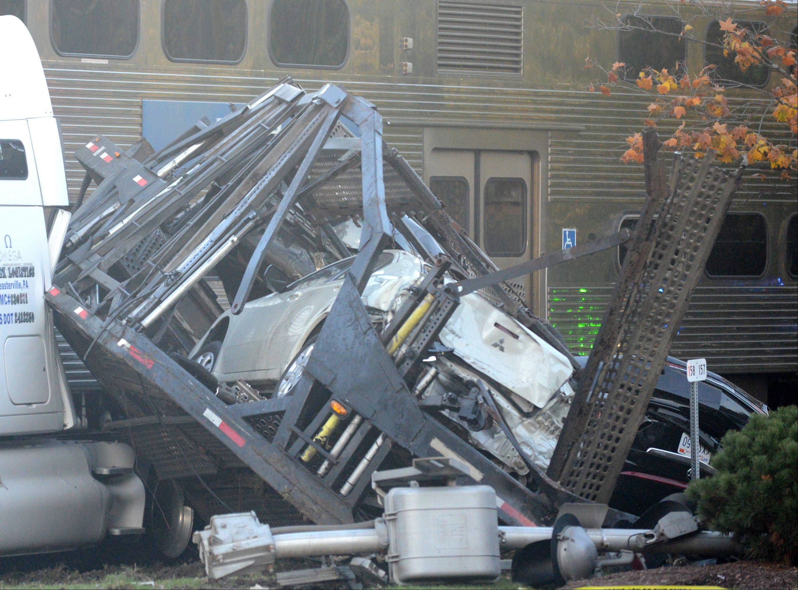 A Metra commuter train on Monday evening just west of the Bartlett train station struck a semitrailer truck loaded with automobiles.